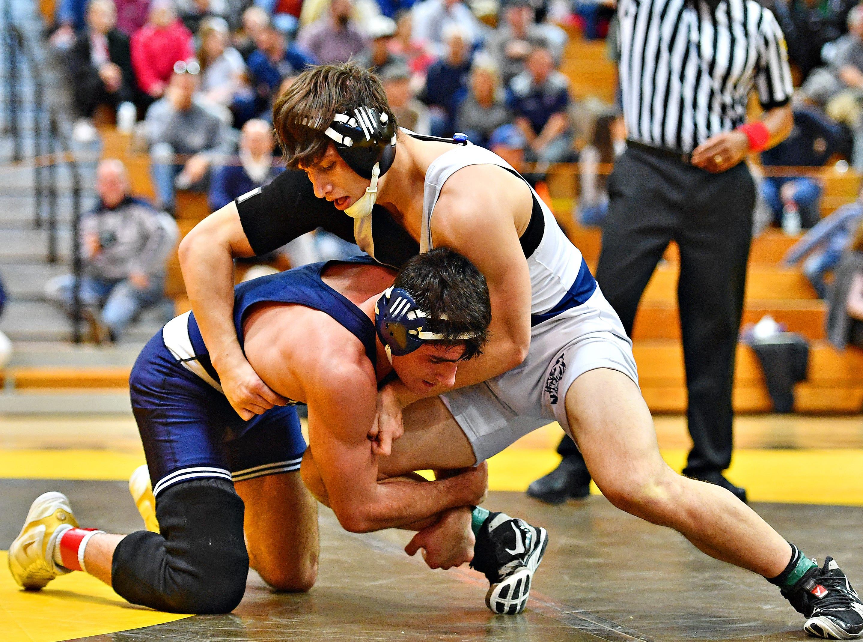 Dallastown's Franklin Klinger, right, wrestles Cedar Cliff's Isaiah Auman in the 170 pound weight class during District 3, Class 3A wrestling championship action at Milton Hershey High School in Hershey, Saturday, Feb. 2, 2019. Dawn J. Sagert photo