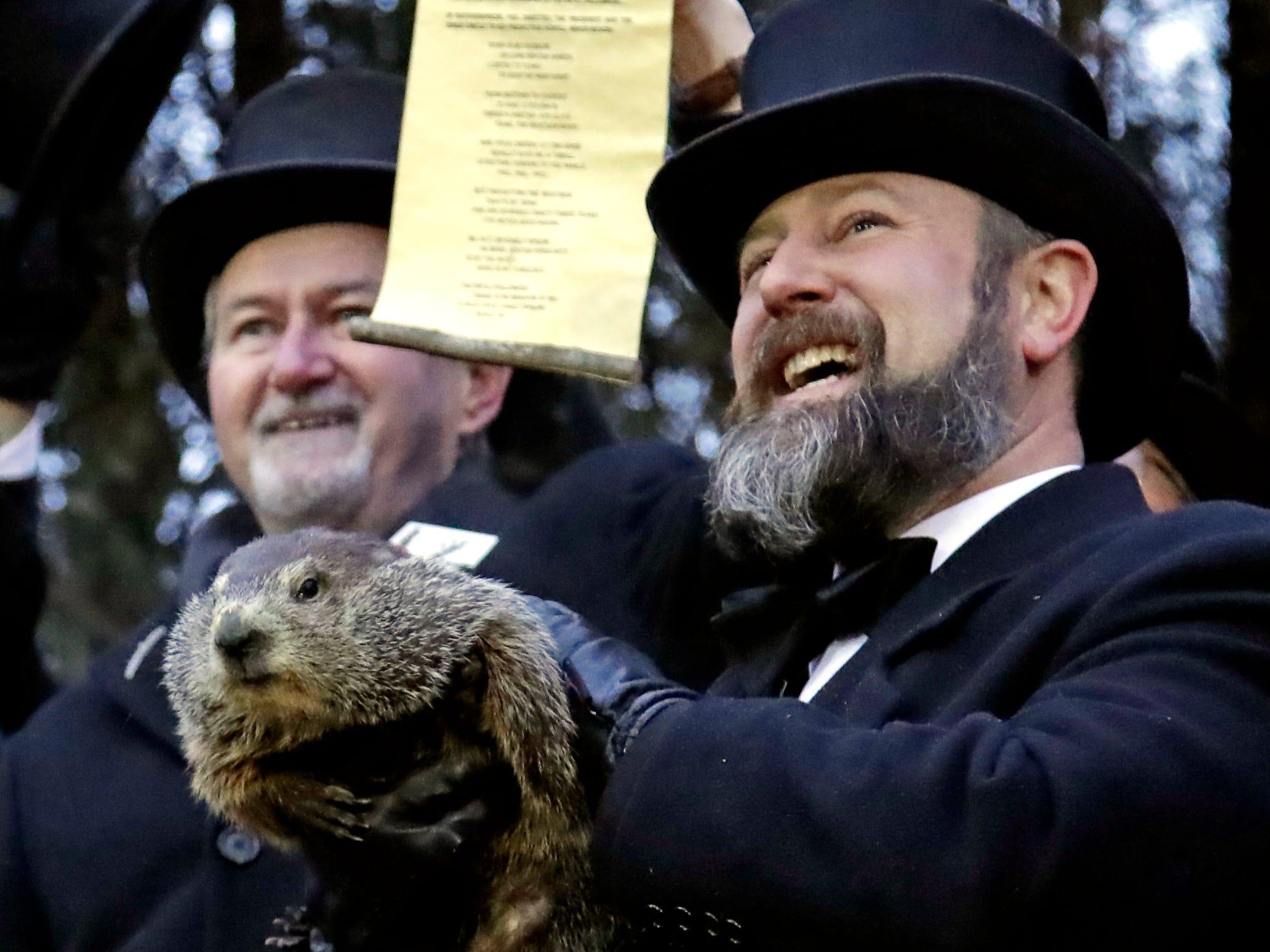 Groundhog Club co-handler Al Dereume, right, holds Punxsutawney Phil, the weather prognosticating groundhog, during the 133rd celebration of Groundhog Day on Gobbler's Knob in Punxsutawney, Pa. Saturday, Feb. 2, 2019. Phil's handlers said that the groundhog has forecast an early spring.