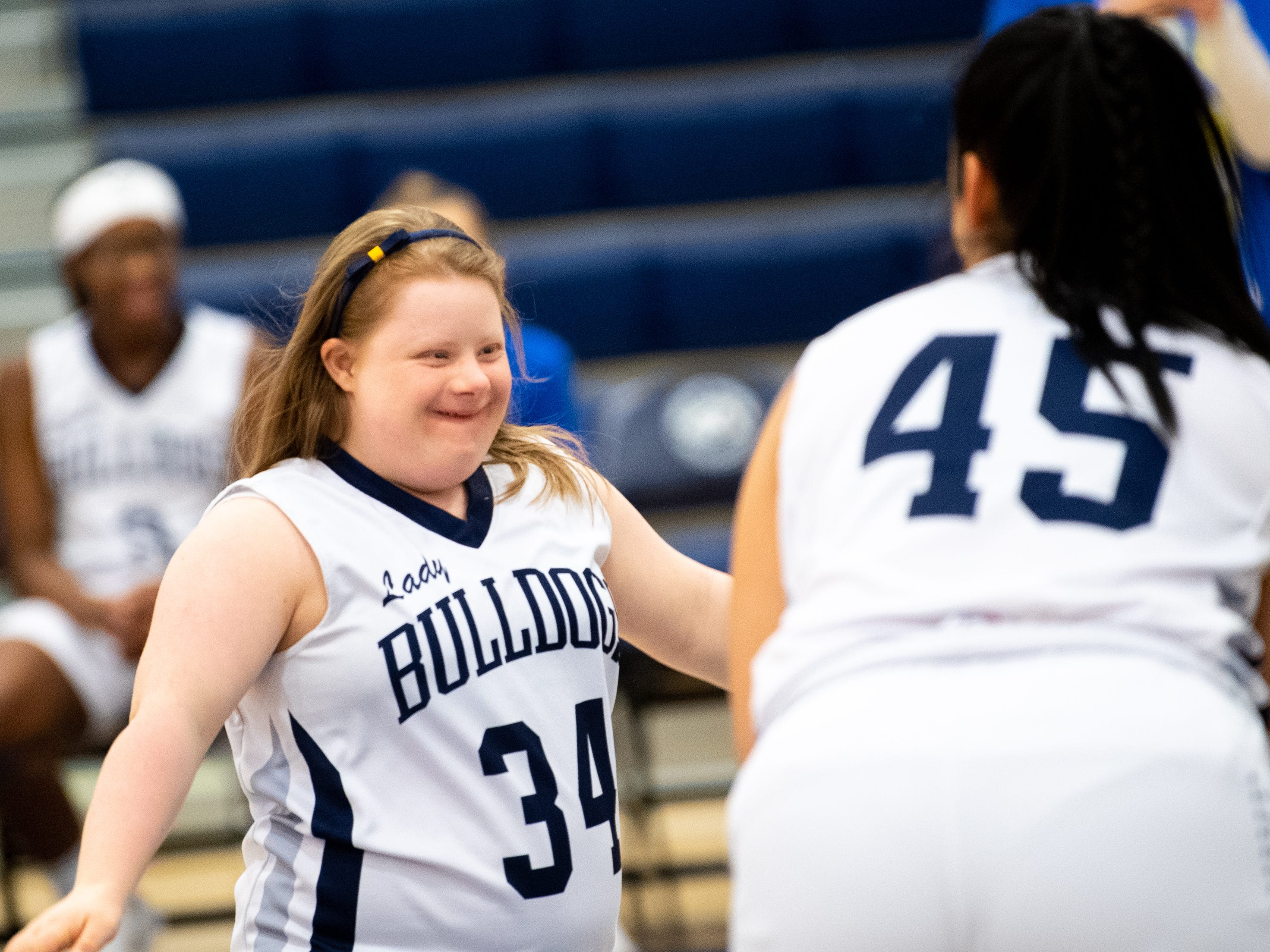 Katie Kniery (34) is all smiles as she makes her way to the basket during the junior varsity girls' basketball game between West York and Dover, February 1, 2019.