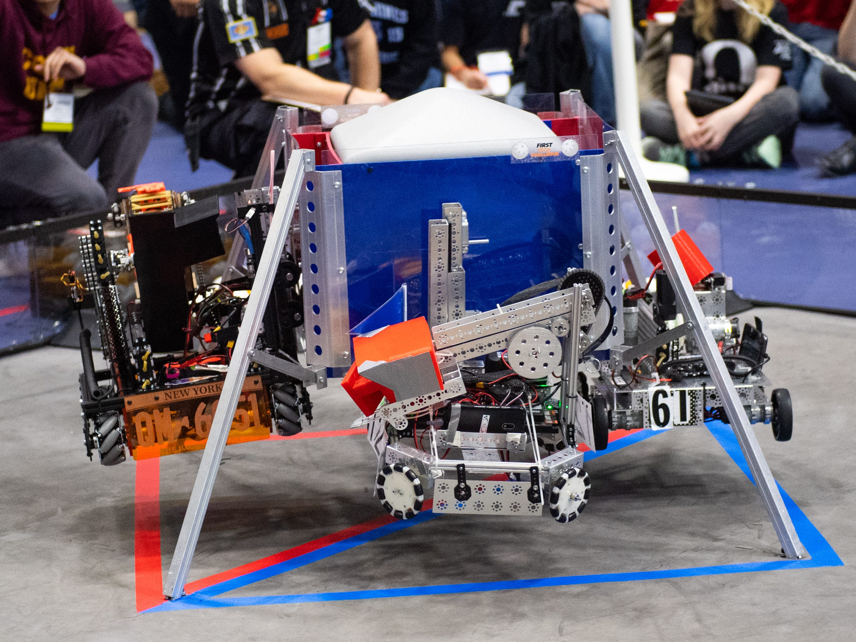 At the start of each match, all four robots are hoisted off of the ground during the First Tech Challenge robotics competition at Penn State York, February 2, 2019.