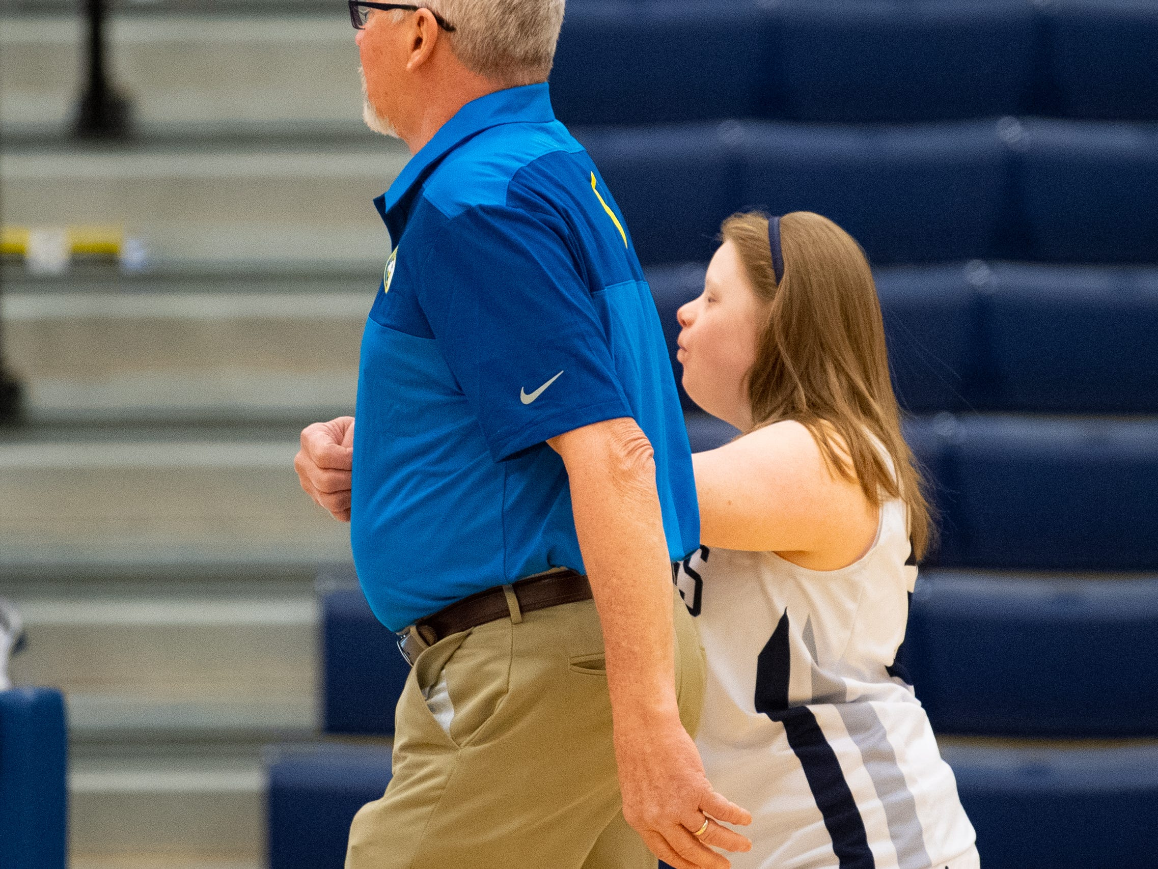 Katie Kniery (34) and coach Al Trimmer walk over to meet the captains before the junior varsity girls' basketball game between West York and Dover, February 1, 2019.