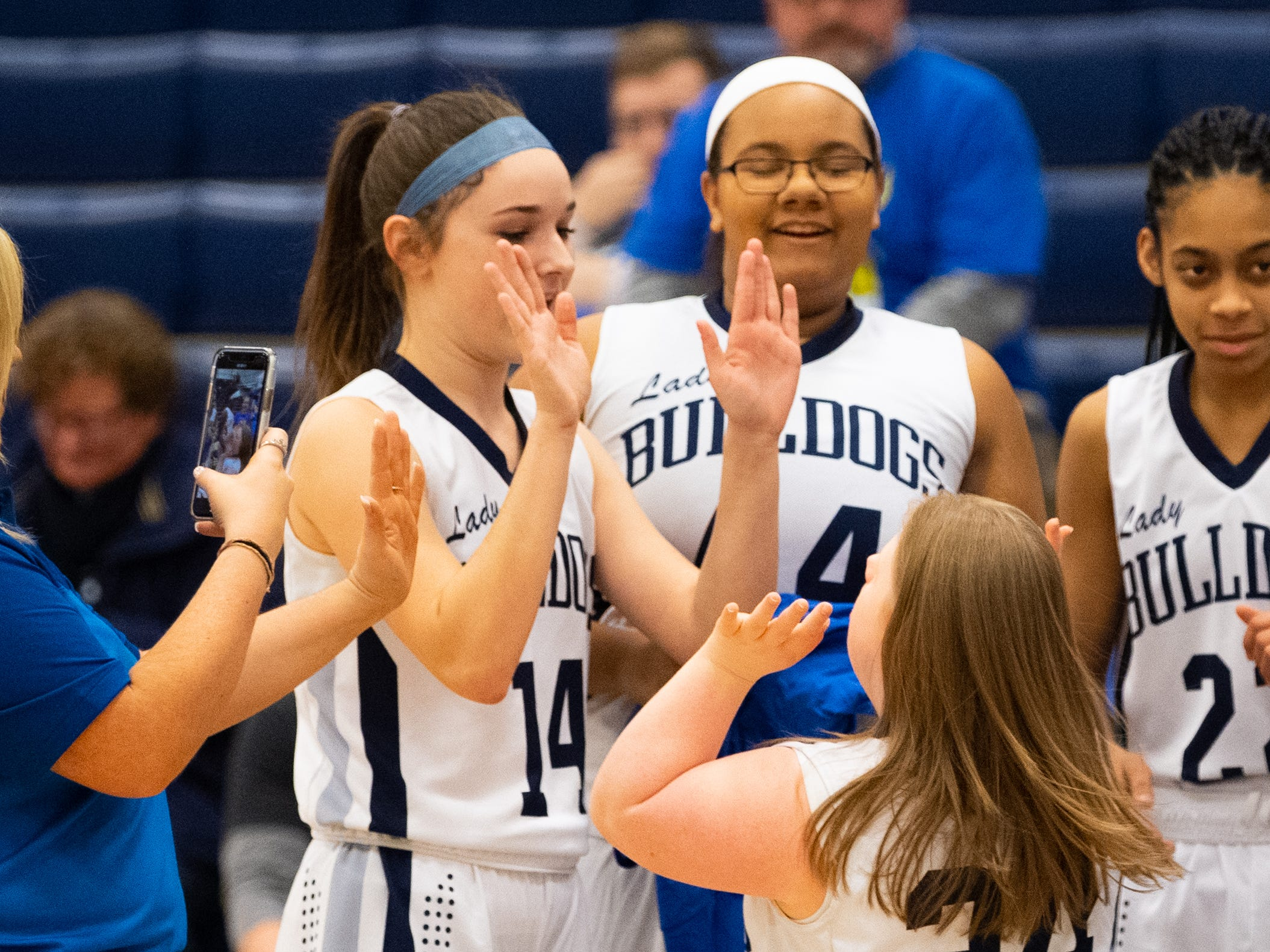 Katie Kniery (34) high-fives her teammates after taking the first few shots of the game, February 1, 2019 at West York Area High School.