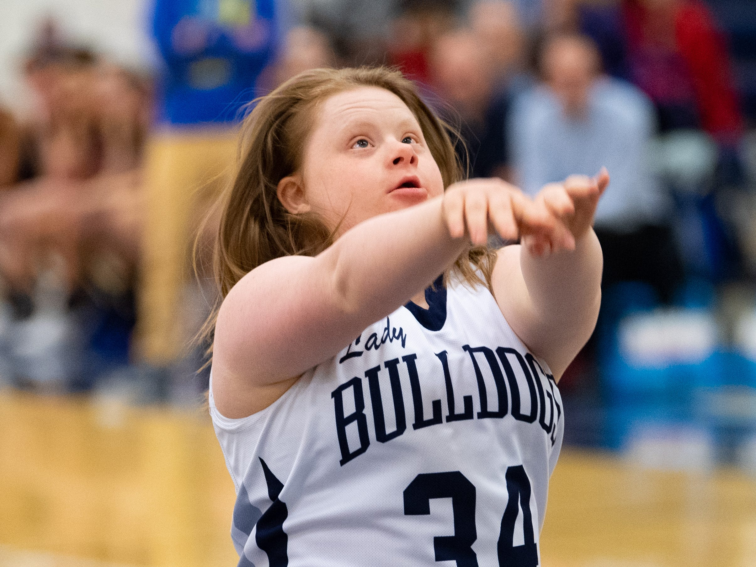 Katie Kniery (34) follows through on her shot during the junior varsity girls' basketball game between West York and Dover, February 1, 2019.