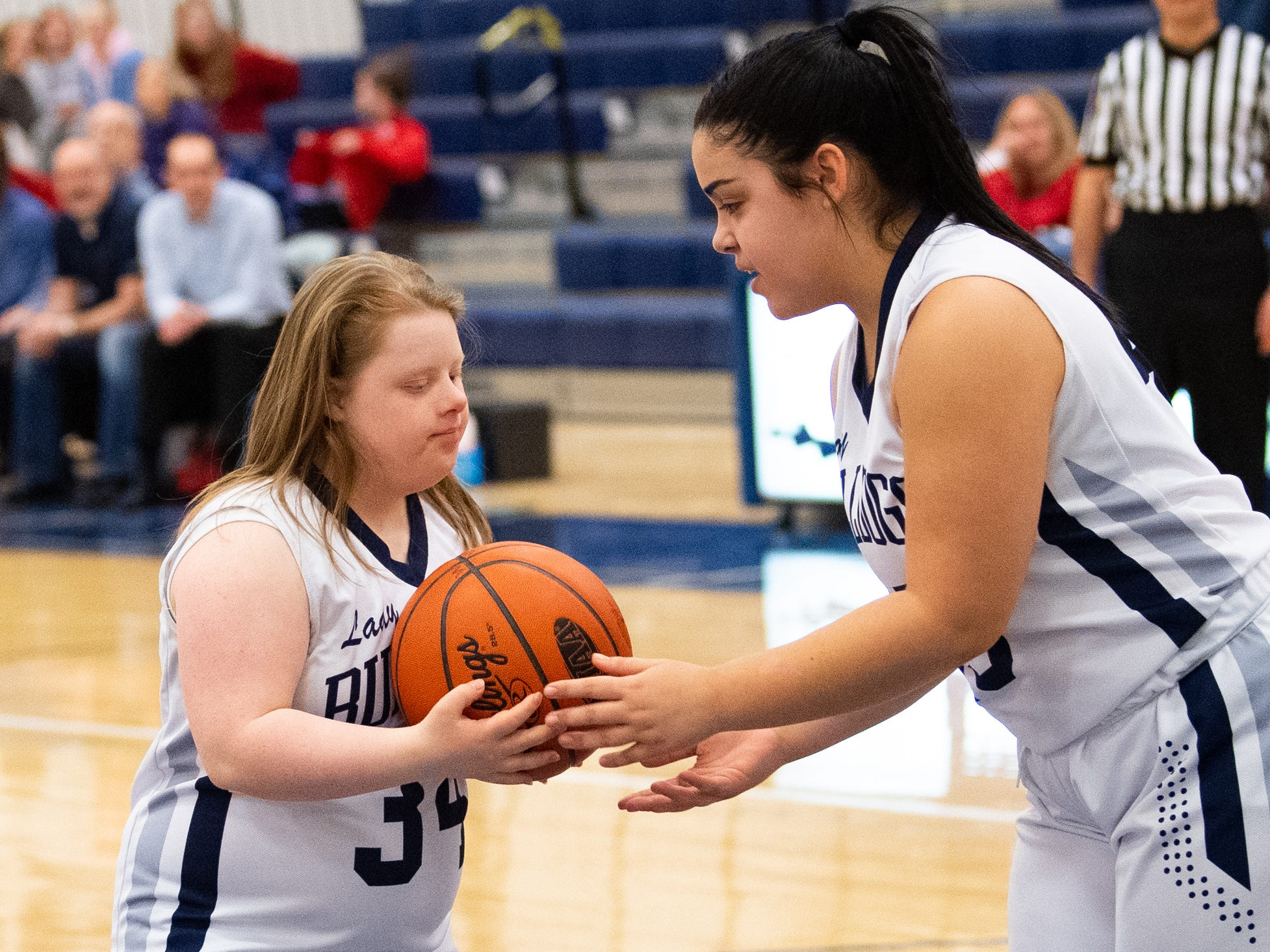 Jada Torres (45) hands Katie Kniery (34) the ball so she can take the shot, February 1, 2019.