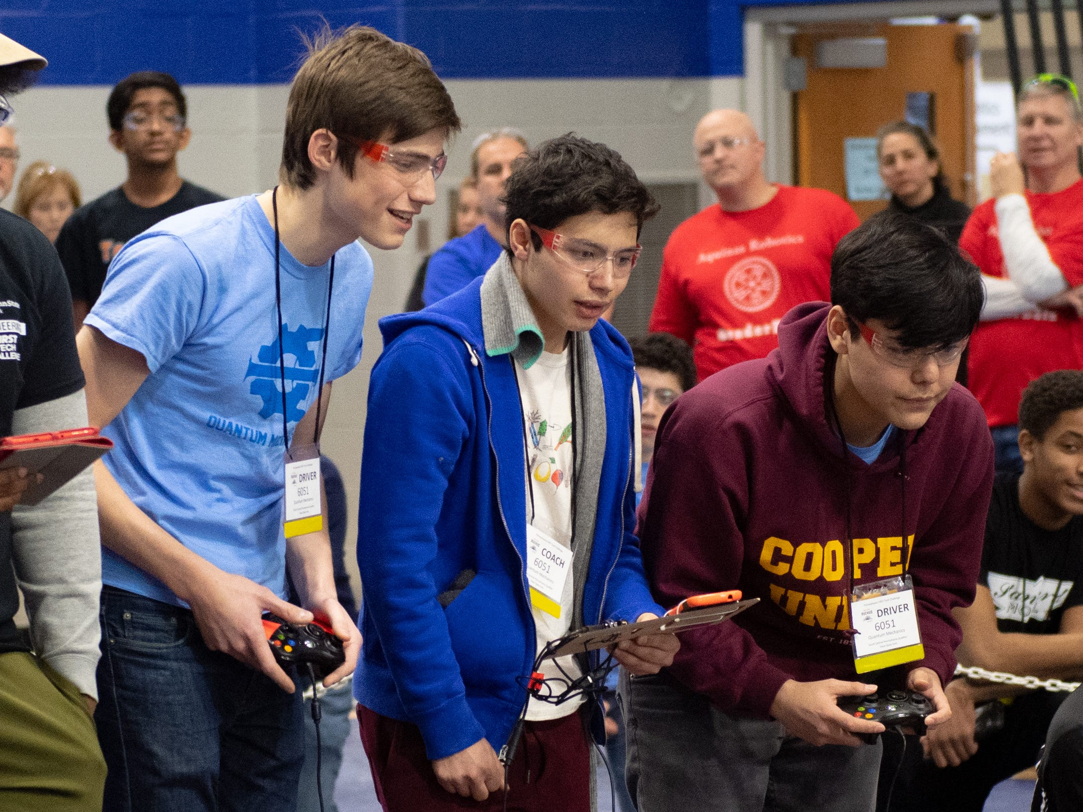 Two drivers and a coach make up each three person team. They must work together closely to be successful during the First Tech Challenge robotics competition, February 2, 2019.