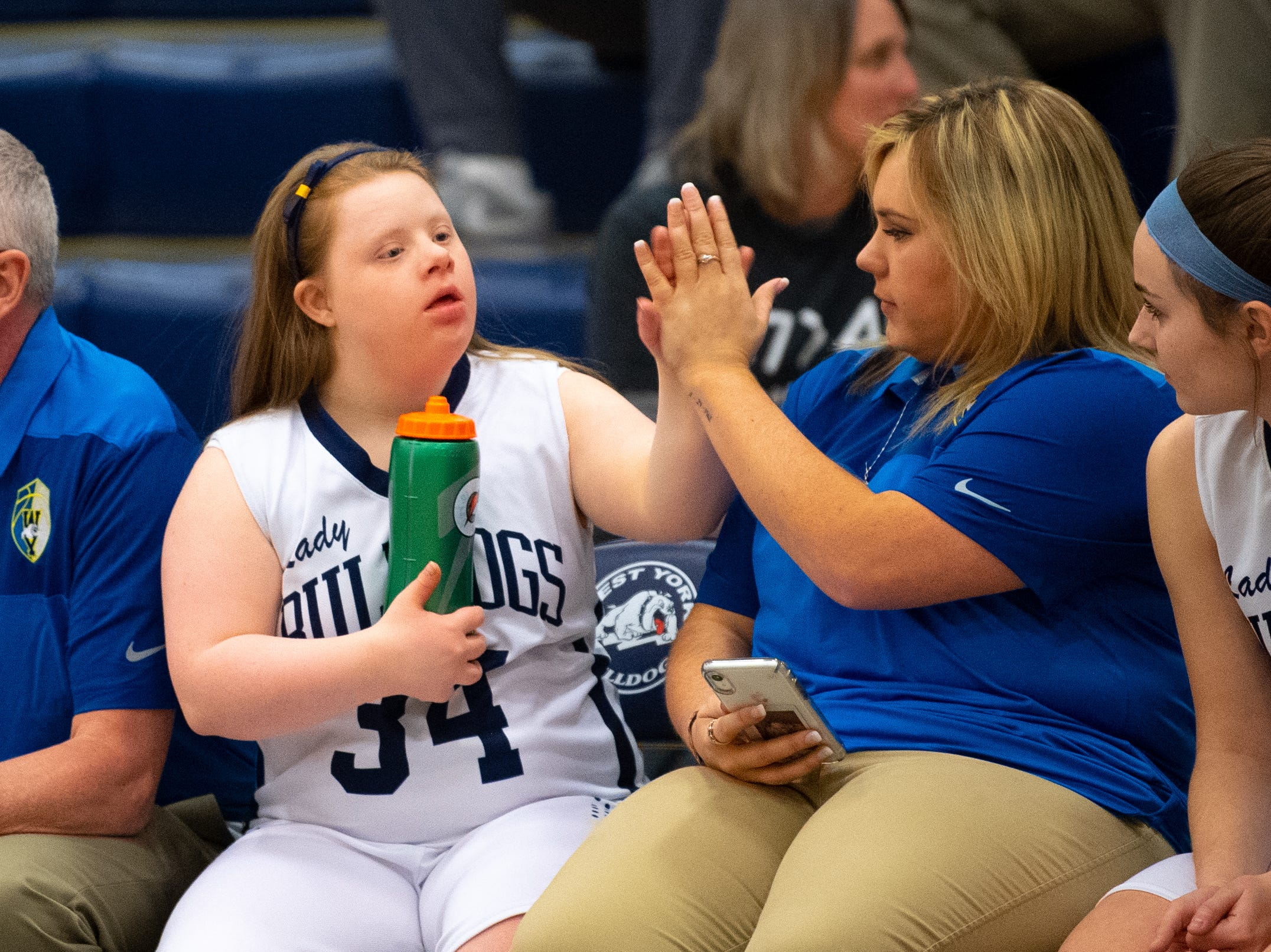 Coach Paige Keiser congratulates Katie Kniery after her junior varsity debut during the junior varsity girls' basketball game between West York and Dover, February 1, 2019 at West York Area High School.