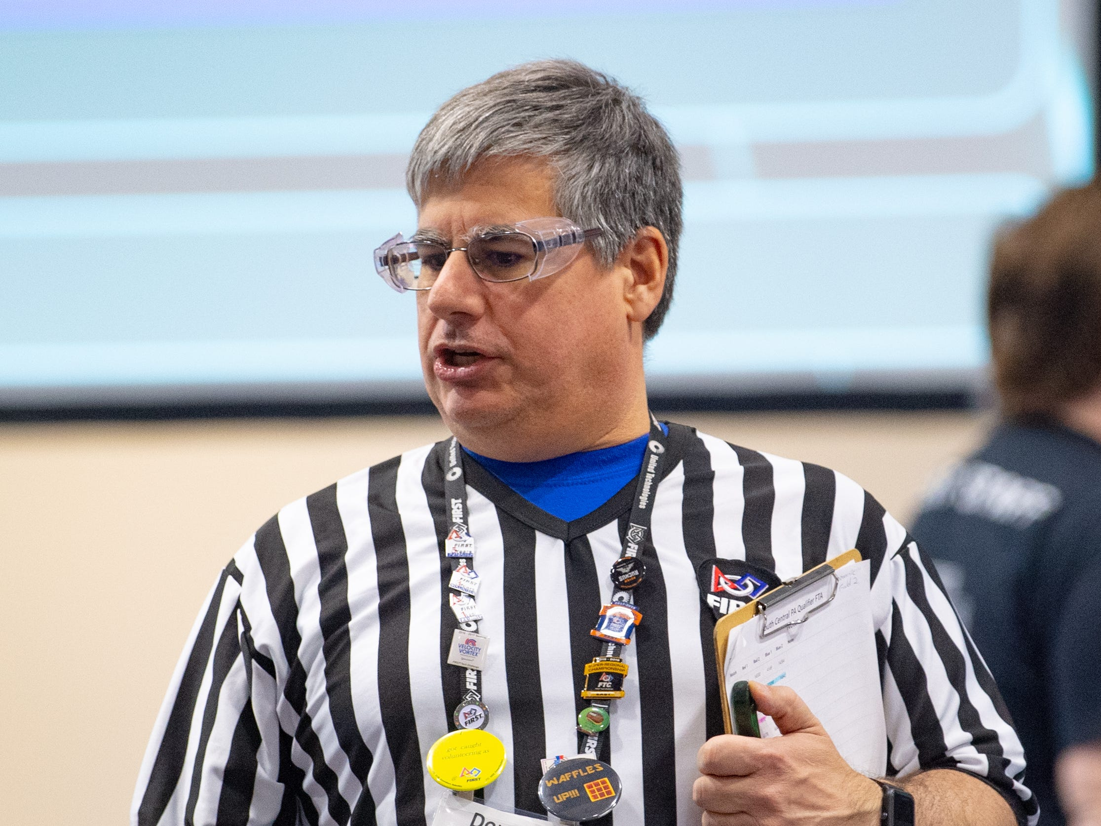 Refs like Dominic Pirocchi officiate the matches to ensure fairness during the First Tech Challenge robotics competition, February 2, 2019.
