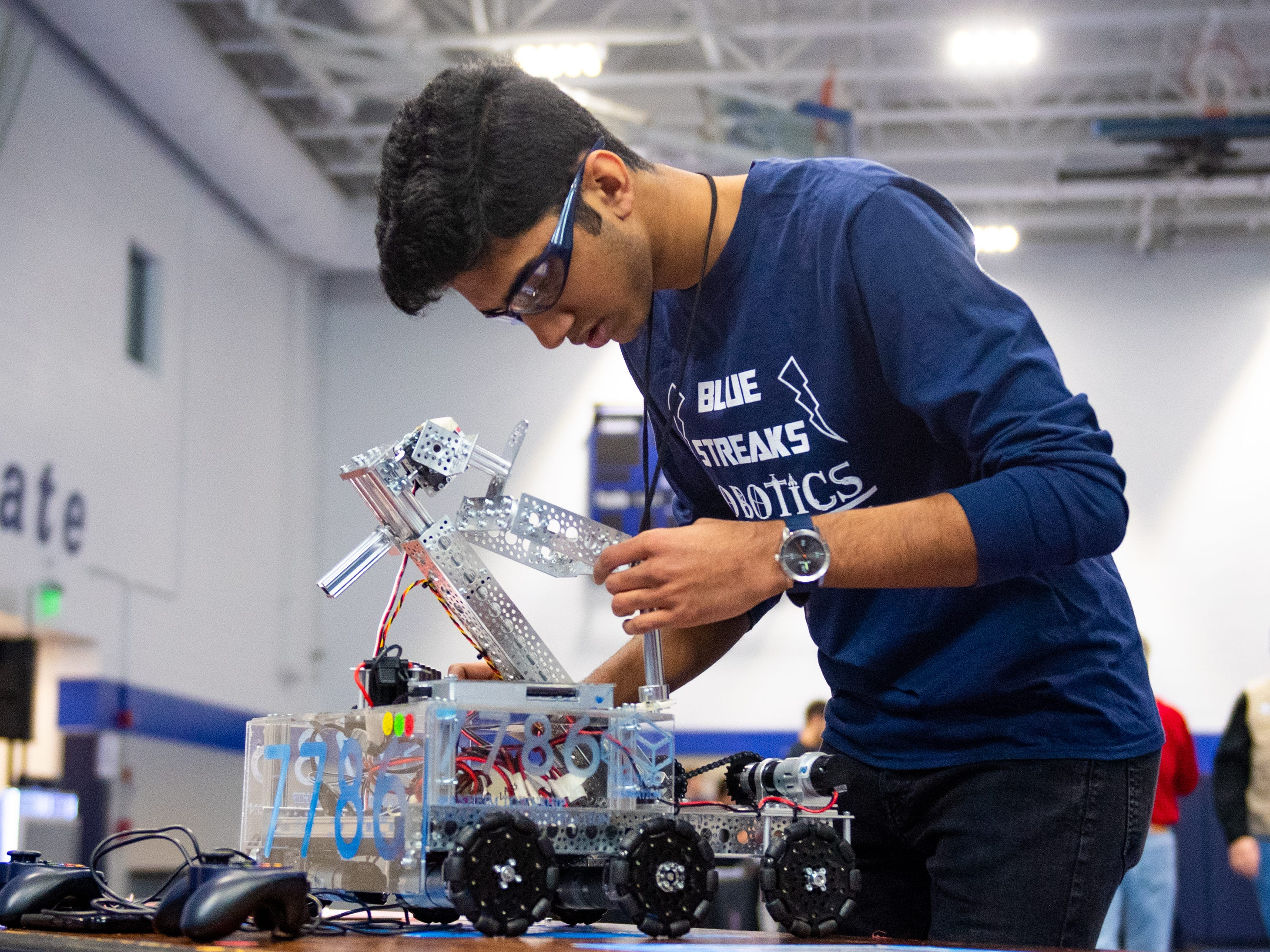 The Manheim Township High School Blue Streaks give their robot one more inspection before taking it to the ring during the First Tech Challenge robotics competition at Penn State York, February 2, 2019.
