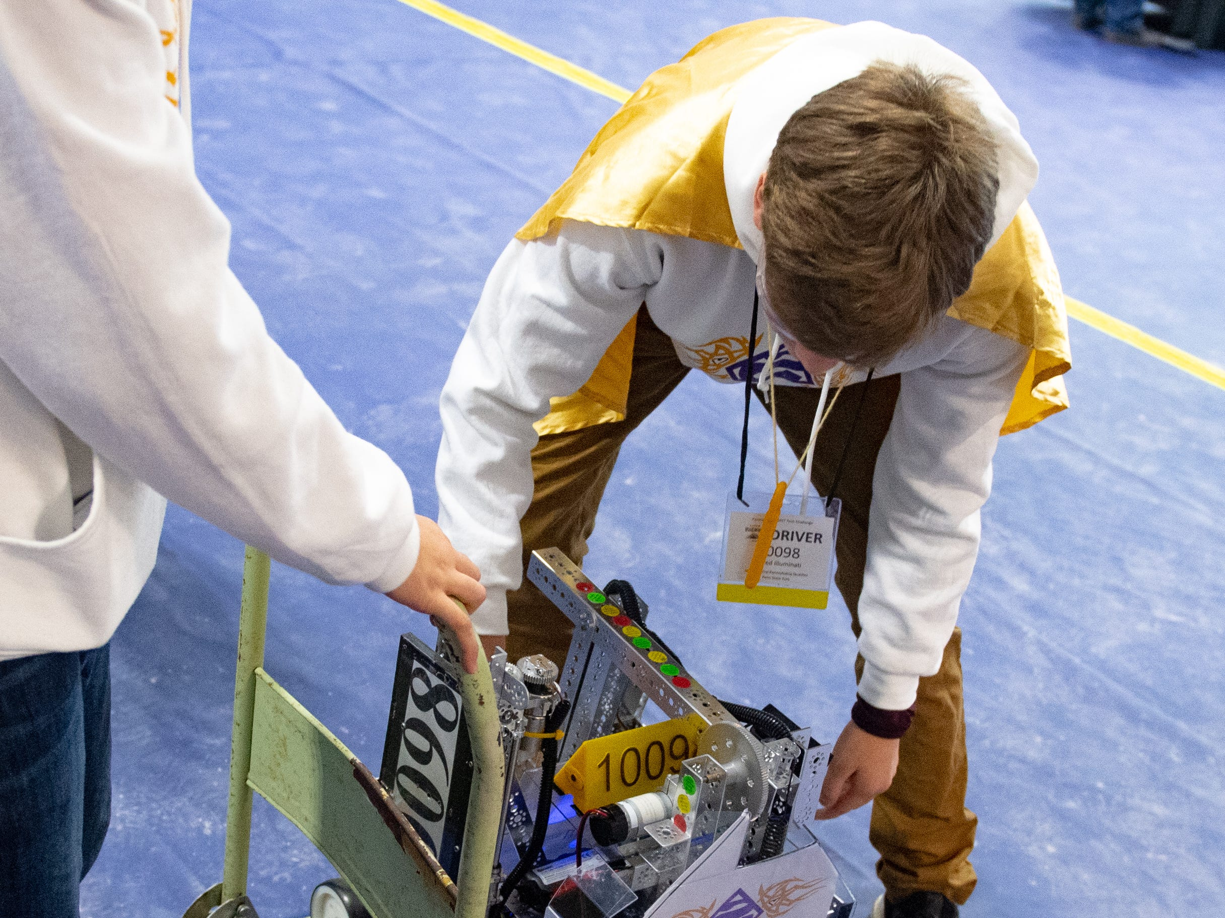 Teams roll their robots around to avoid any accidental damage during the First Tech Challenge robotics competition at Penn State York, February 2, 2019.