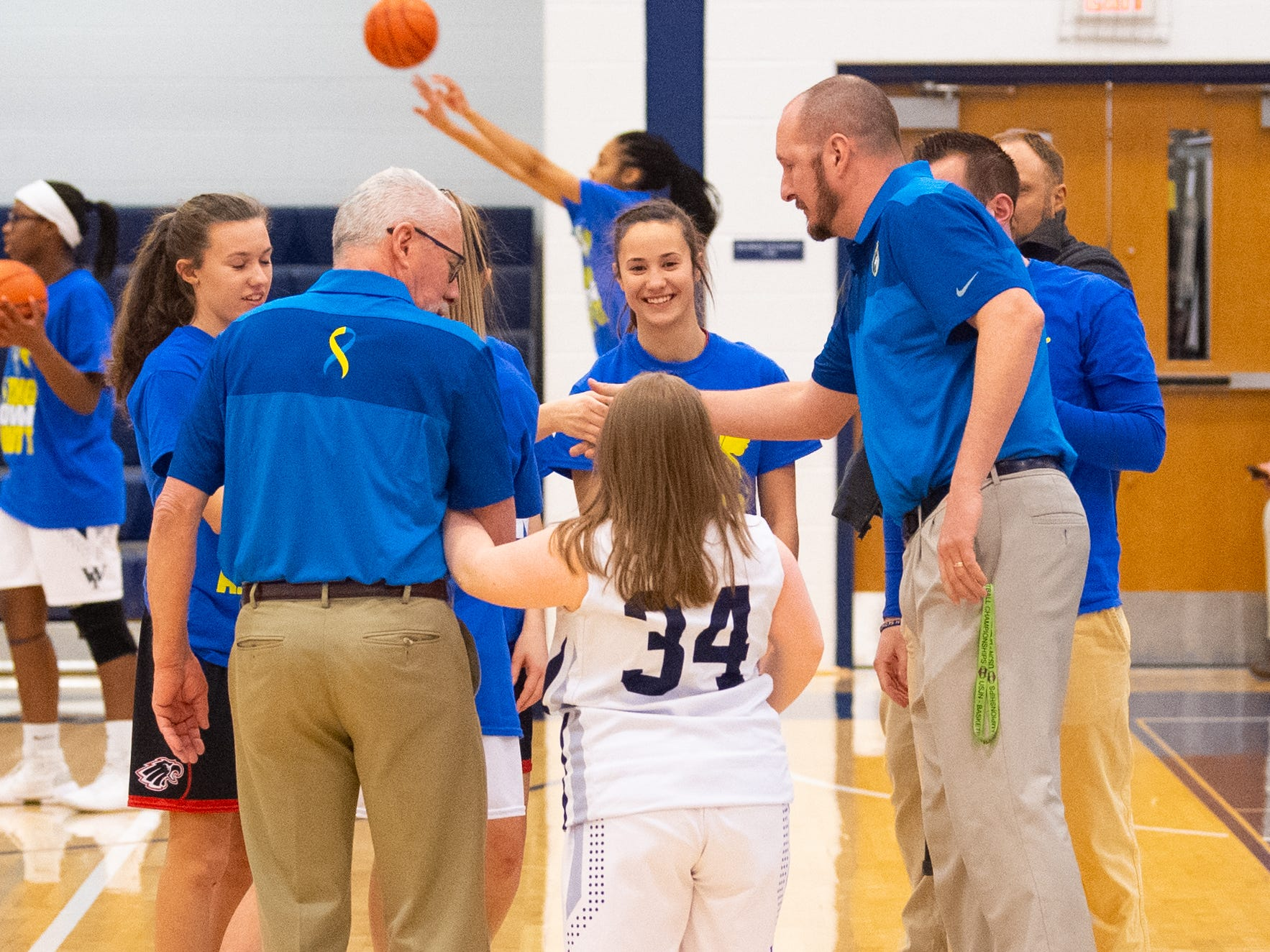 Katie Kniery (34) meets Dover's captains before the junior varsity girls' basketball game between West York and Dover, February 1, 2019.