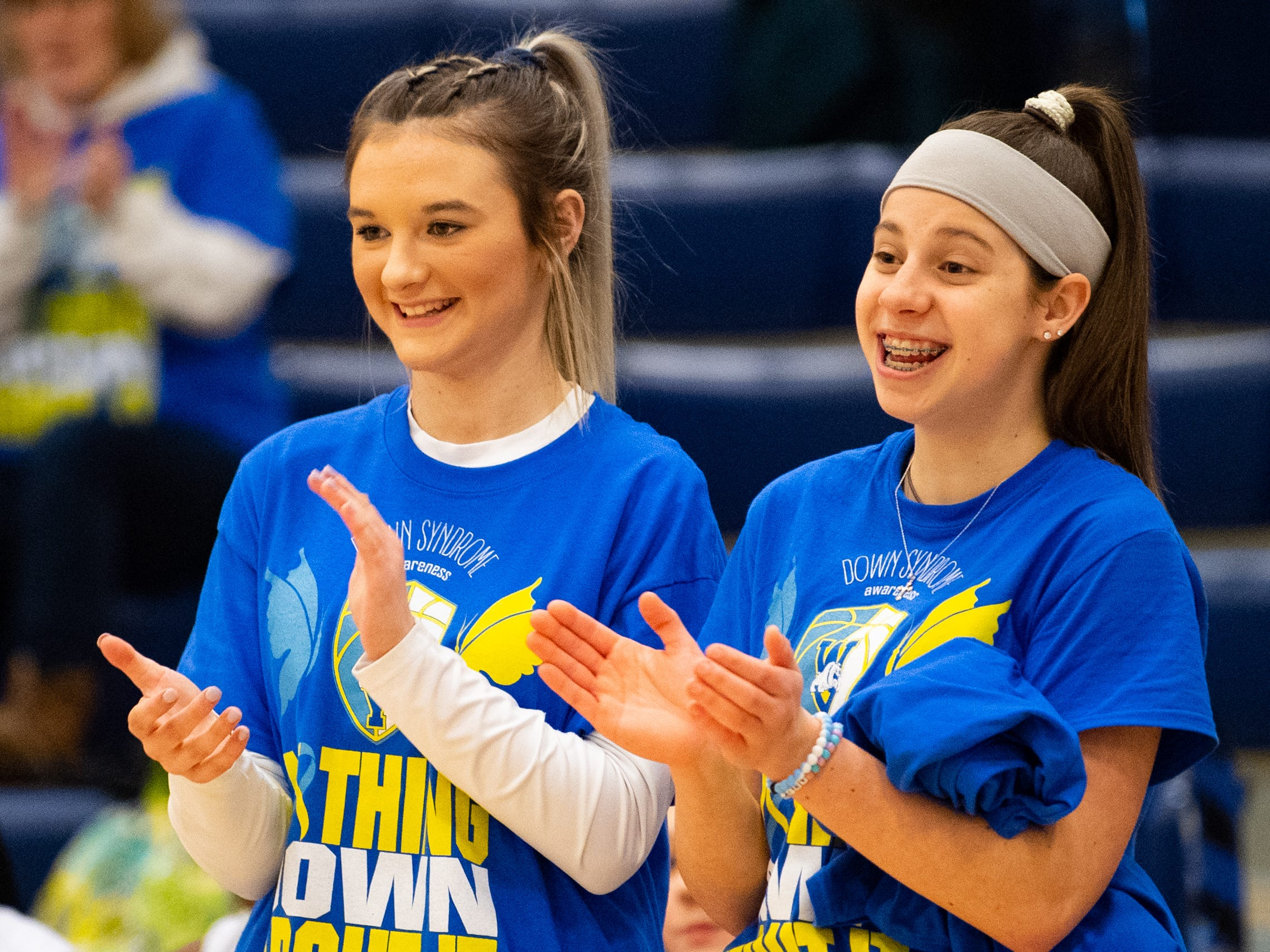 West York varsity players Makennah Hoffman (left) and Alainna Hopta (right) cheer on Katie Kniery while wearing special shirts dedicated to her, February 1, 2019.