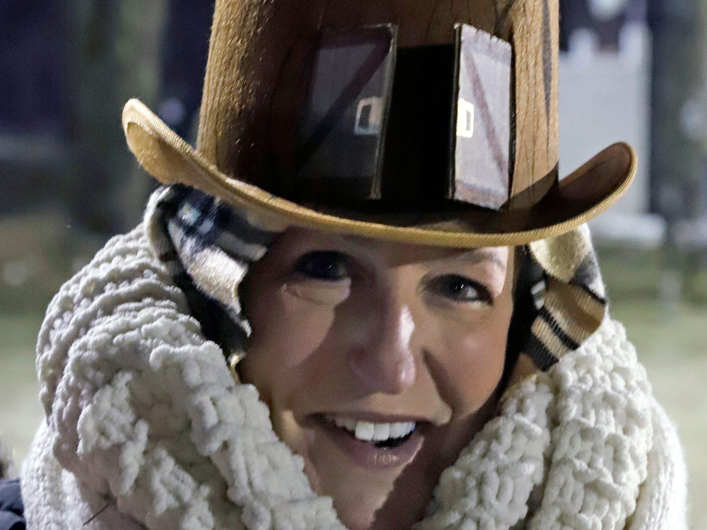 Lisa Gibson of Pittsburgh arrives bundled up to begin celebrating the 133rd Groundhog Day on Gobbler's Knob in Punxsutawney, Pa. Saturday, Feb. 2, 2019. (AP Photo/Gene J. Puskar)