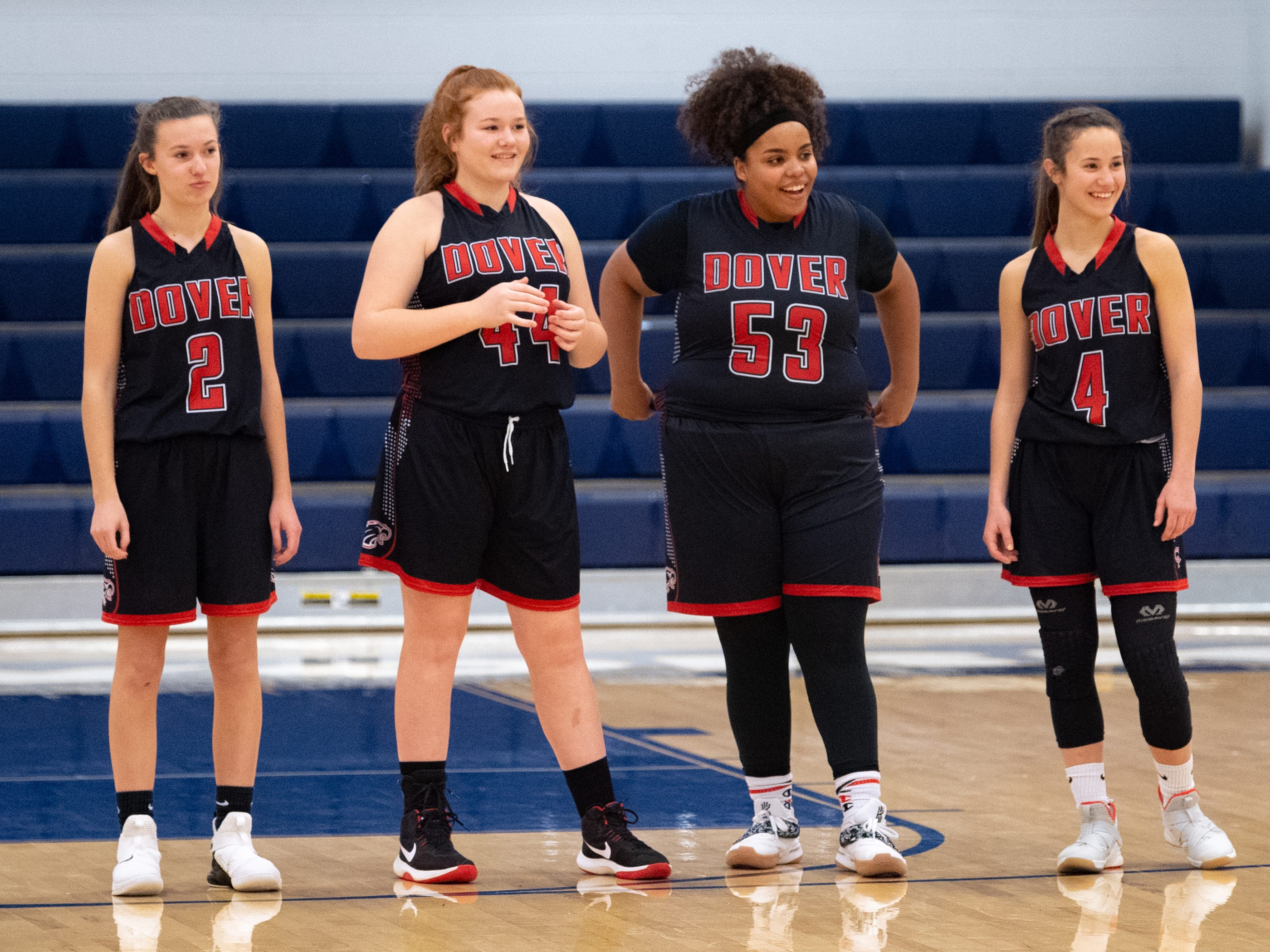 Dover's junior varsity players watch as Katie Kniery takes the first shot of the game, February 1, 2019.