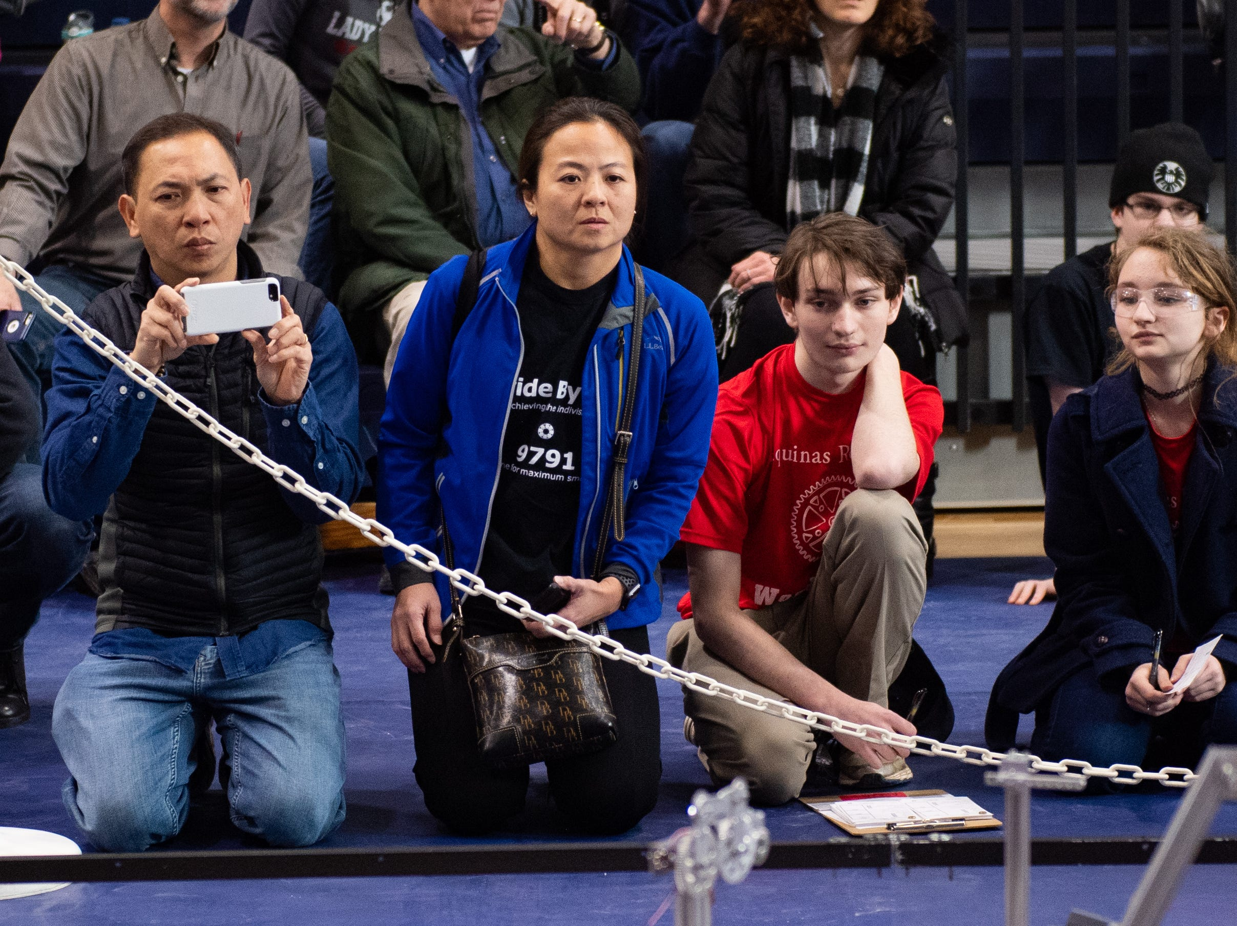 Parents, fans and fellow competitors watch each match closely during the First Tech Challenge robotics competition at Penn State York, February 2, 2019.