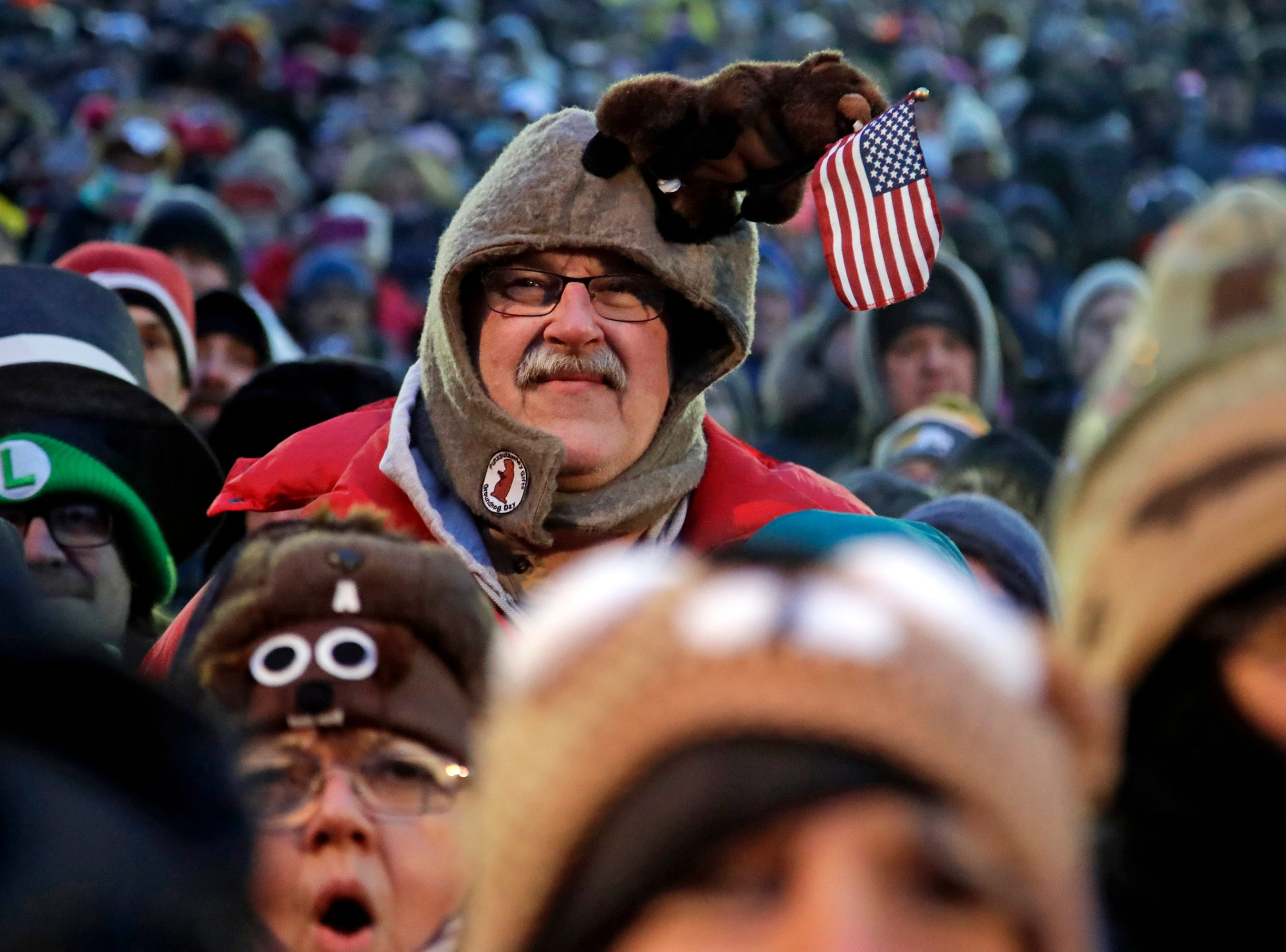Al Donst of Belvidere, NJ, center, participates in the 133rd celebration of Groundhog Day on Gobbler's Knob in Punxsutawney, Pa. Saturday, Feb. 2, 2019. Phil's handlers said that the groundhog has forecast an early spring. (AP Photo/Gene J. Puskar)