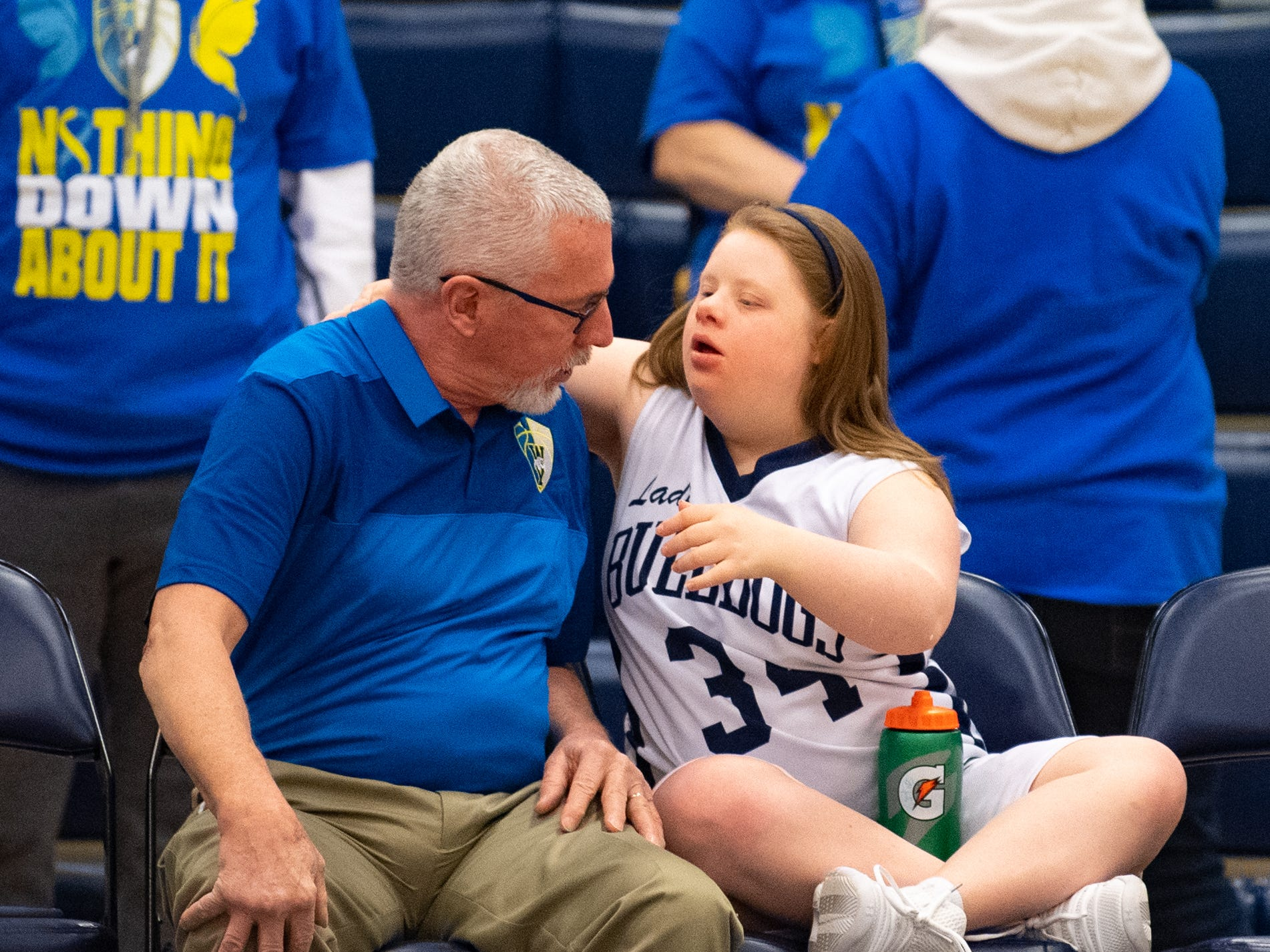 Katie Kniery (34) and West York coach Al Trimmer discuss the plays before the junior varsity girls' basketball game between West York and Dover, February 1, 2019 at West York Area High School.