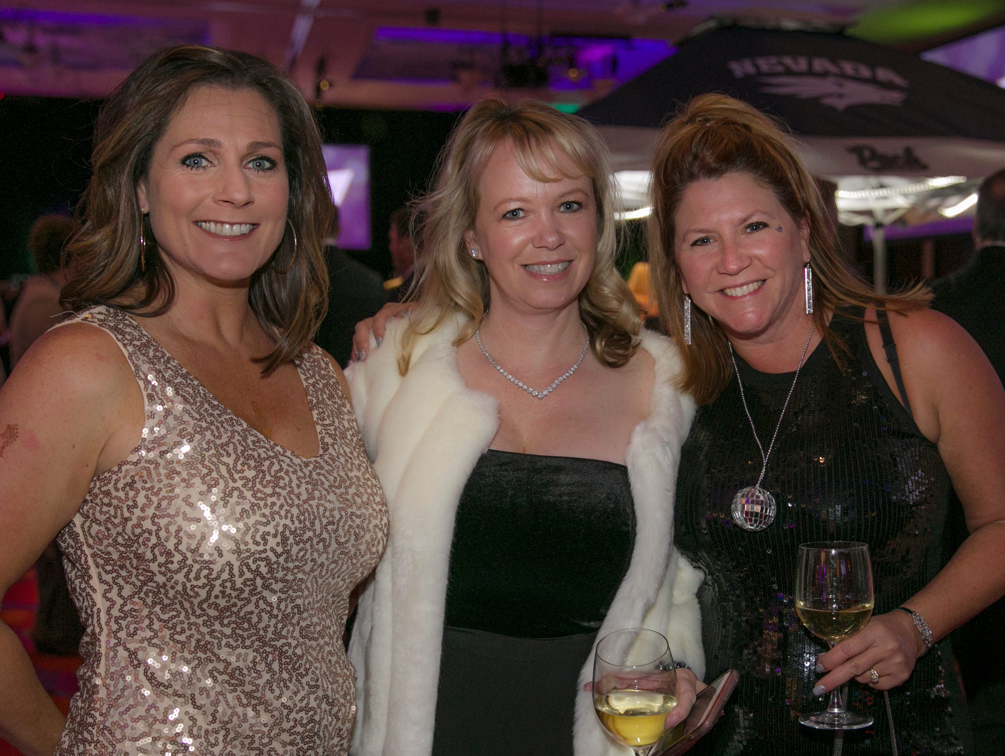 Tammy Barkowski, Billie Doyle and Laura Worrall during the 10th Annual Blue Tie Ball at the Peppermill Resort Spa Casino in Reno, NV on Friday night, Feb. 1, 2019.