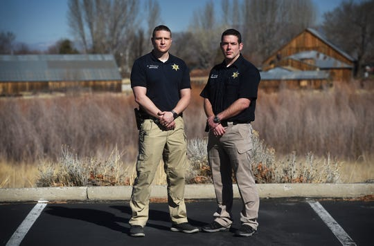 Douglas County Sheriff's investigators Ryan Young, right, and Brandon Williamson pose for a portrait in Minden on Jan. 31, 2019.