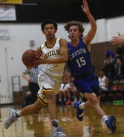 Galena's Isaiah Duve drives while taking on Carson during their basketball game in Reno on Friday.