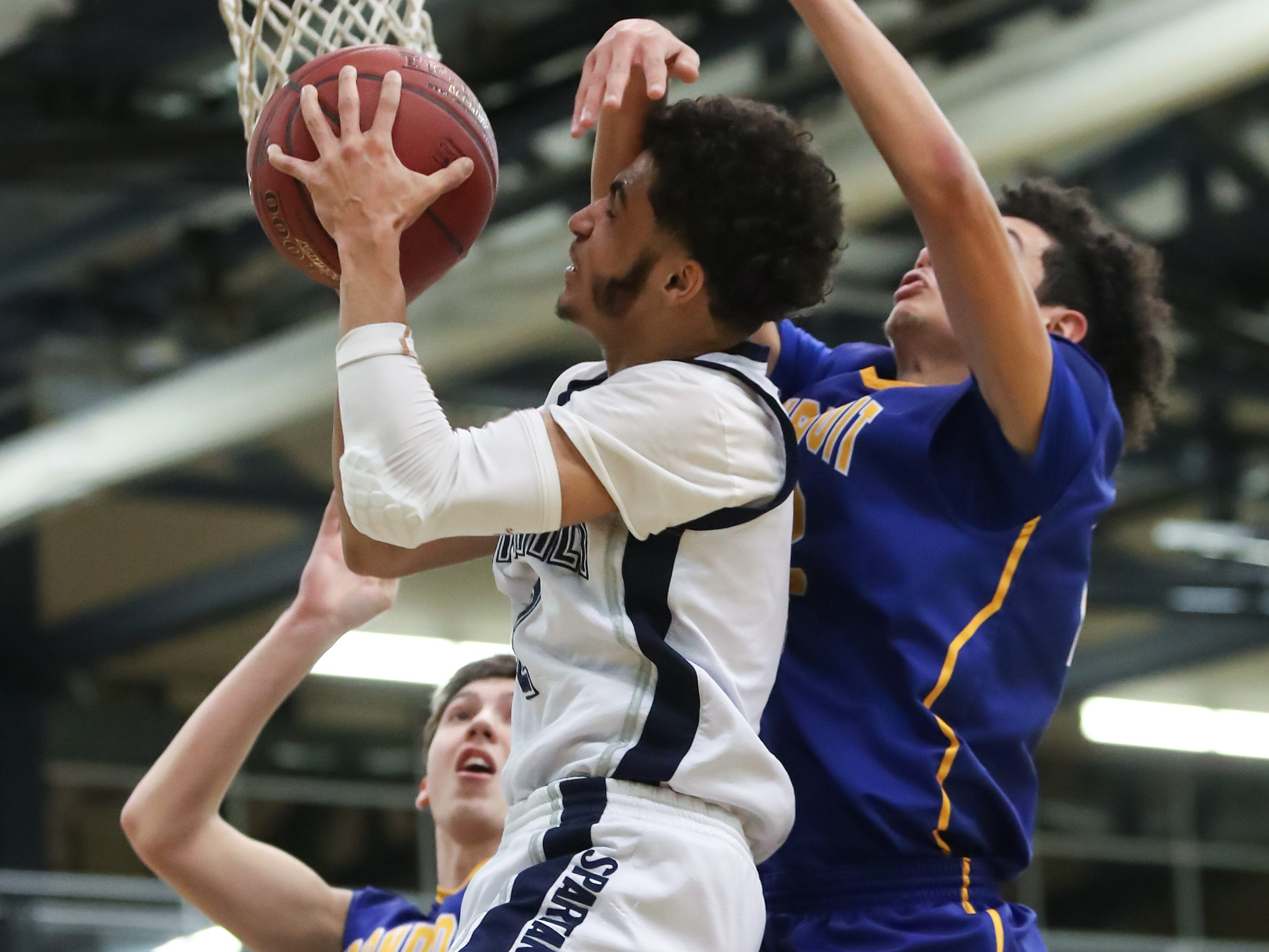 Gates Chili guard Devin Walton (2) goes to the hoop against Irondequoit forward Kenny Gonzalez (22) during a Section V high school boys basketball game at Gates Chili High School on Feb. 1, 2019.