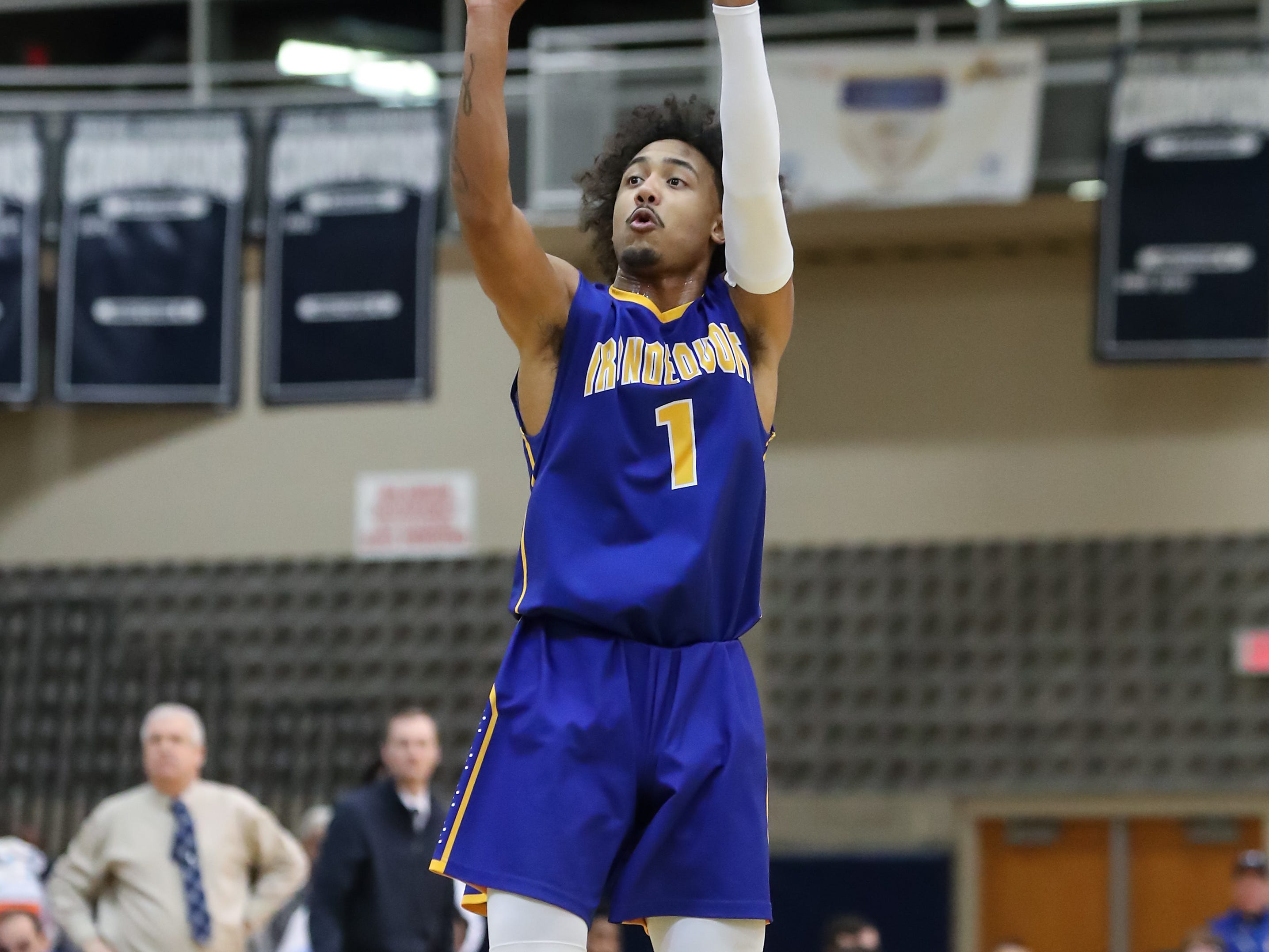 Irondequoit guard Freddy June Jr (1) attempts a 3-pointer against Gates Chili during a Section V high school boys basketball game at Gates Chili High School on Feb. 1, 2019.