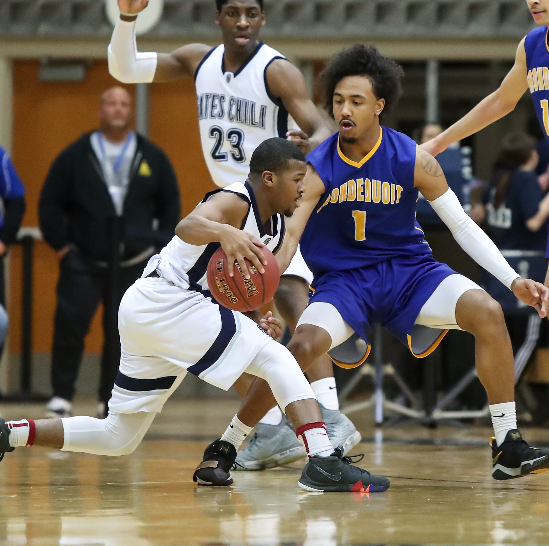 Gates Chili guard Keith Slack (3) is defended by Irondequoit guard Freddy June Jr (1) during a Section V high school boys basketball game at Gates Chili High School on Feb. 1, 2019.