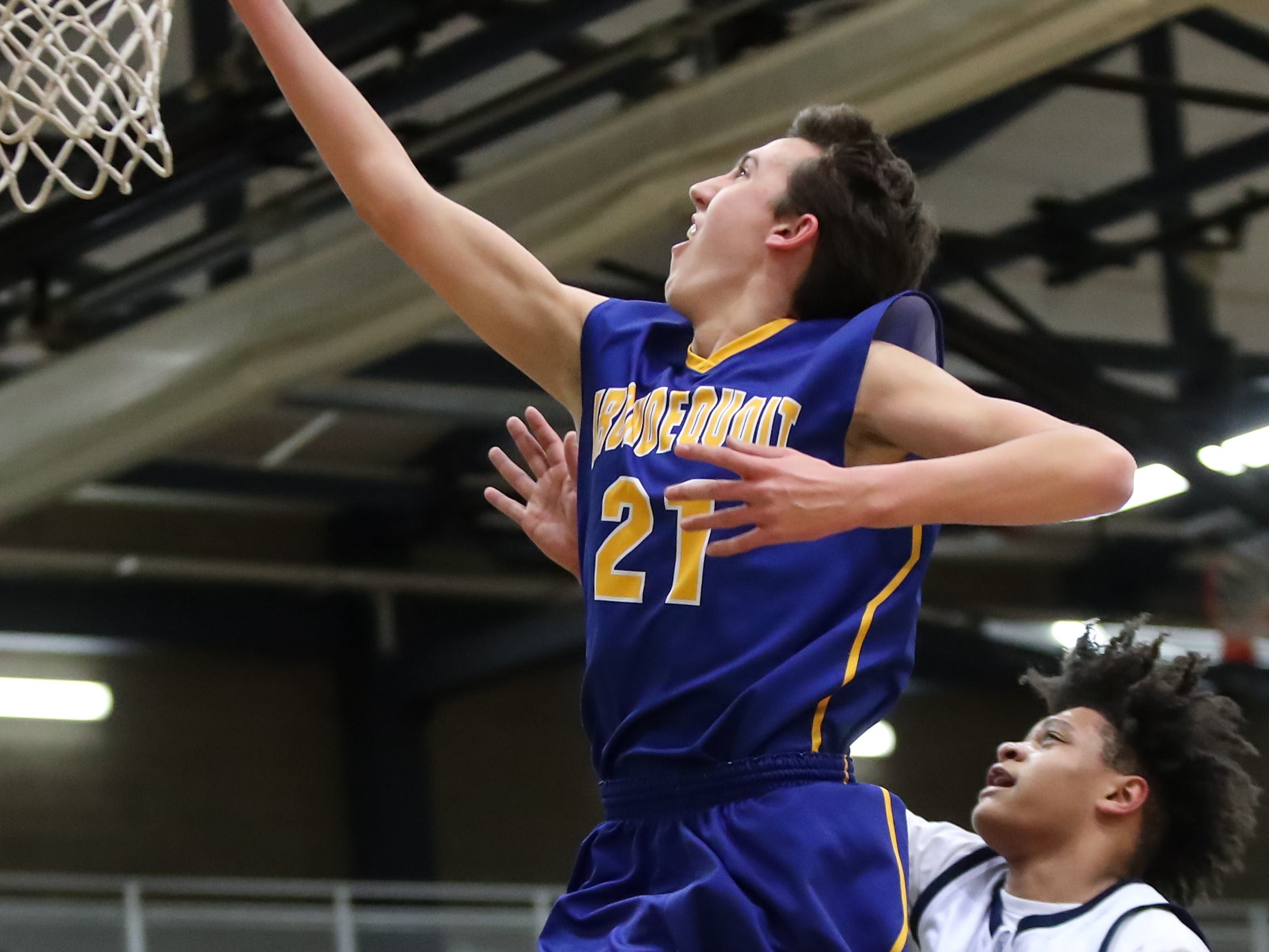Josh Stenglein (21) of Irondequoit lays the ball up against Gates Chili during a Section V high school boys basketball game at Gates Chili High School on Feb. 1, 2019.