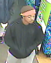 Surveillance image of a robbery suspect on Friday, Feb. 1, 2019 walking into a Rite Aid on East Cypress Avenue in Redding.