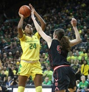 Oregon's Ruthy Hebard shoots over Utah's Megan Huff during the first quarter of an NCAA college basketball game Friday, Feb. 1, 2019, in Eugene, Ore.
