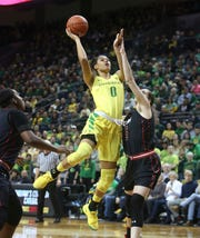 Oregon's Satou Sabally shots over Utah's Megan Huff during the first quarter of an NCAA college basketball game Friday, Feb. 1, 2019, in Eugene, Ore.