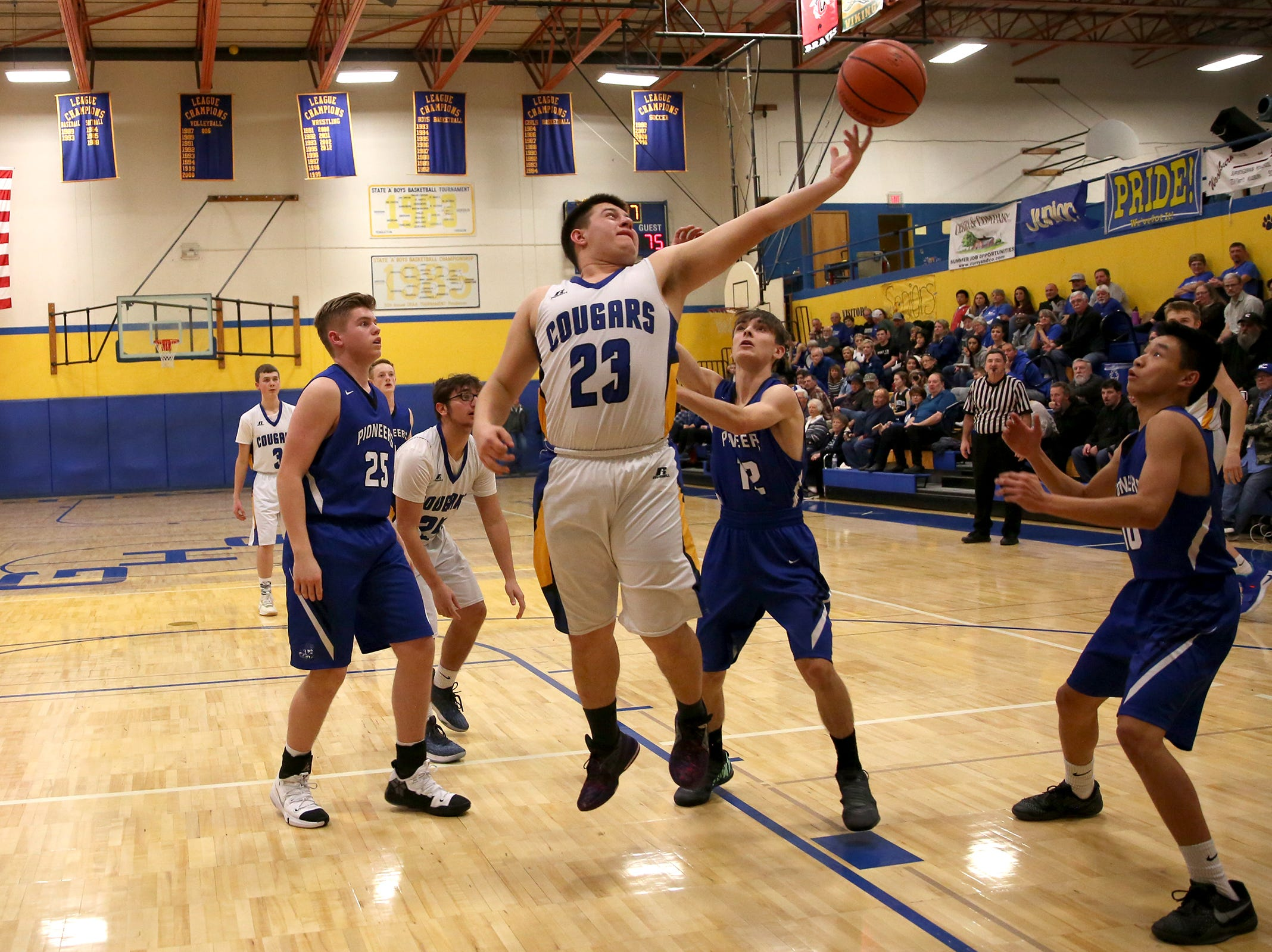 Gervais' Alejandro Contreras (23) rebounds the ball during the Gervais High School boys basketball game against Western Christian in Gervais on Friday, Feb. 1, 2019.