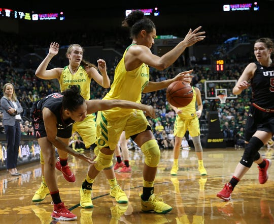 Utah's Kiana Moore, left, has the ball stolen under pressure from Oregon's Sabrina Ionescu and Satou Sabally with Utah's Megan Huff, right, watching during the fourth quarter of an NCAA college basketball game Friday, Feb. 1, 2019, in Eugene, Ore.