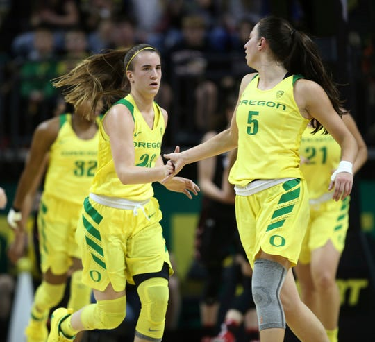 Oregon's Sabrina Ionescu, front left, congratulates Maite Cazorla, right, at the end of the second quarter against Utah in an NCAA college basketball game Friday, Feb. 1, 2019, in Eugene, Ore.