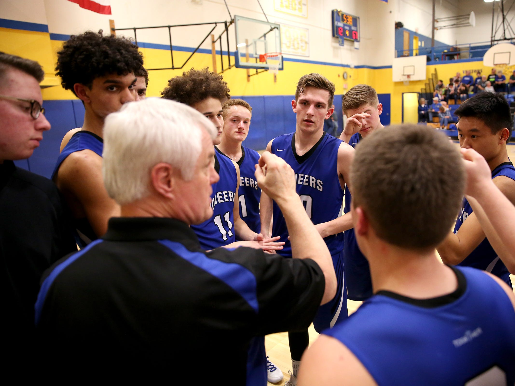 Western Christian huddles during the Gervais High School boys basketball game against Western Christian in Gervais on Friday, Feb. 1, 2019.