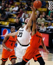 Colorado forward Lucas Siewert, left, blocks a shot by Oregon State guard Stephen Thompson Jr. who drives to the rim in the first half of an NCAA college basketball game Thursday, Jan. 31, 2019, in Boulder, Colo.
