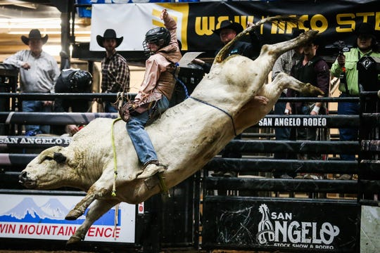 Daniel Keeping rides a bull during the 2nd performance of the San Angelo Stock Show & Rodeo  Saturday, Feb. 2, 2019, at Foster Communications Coliseum.
