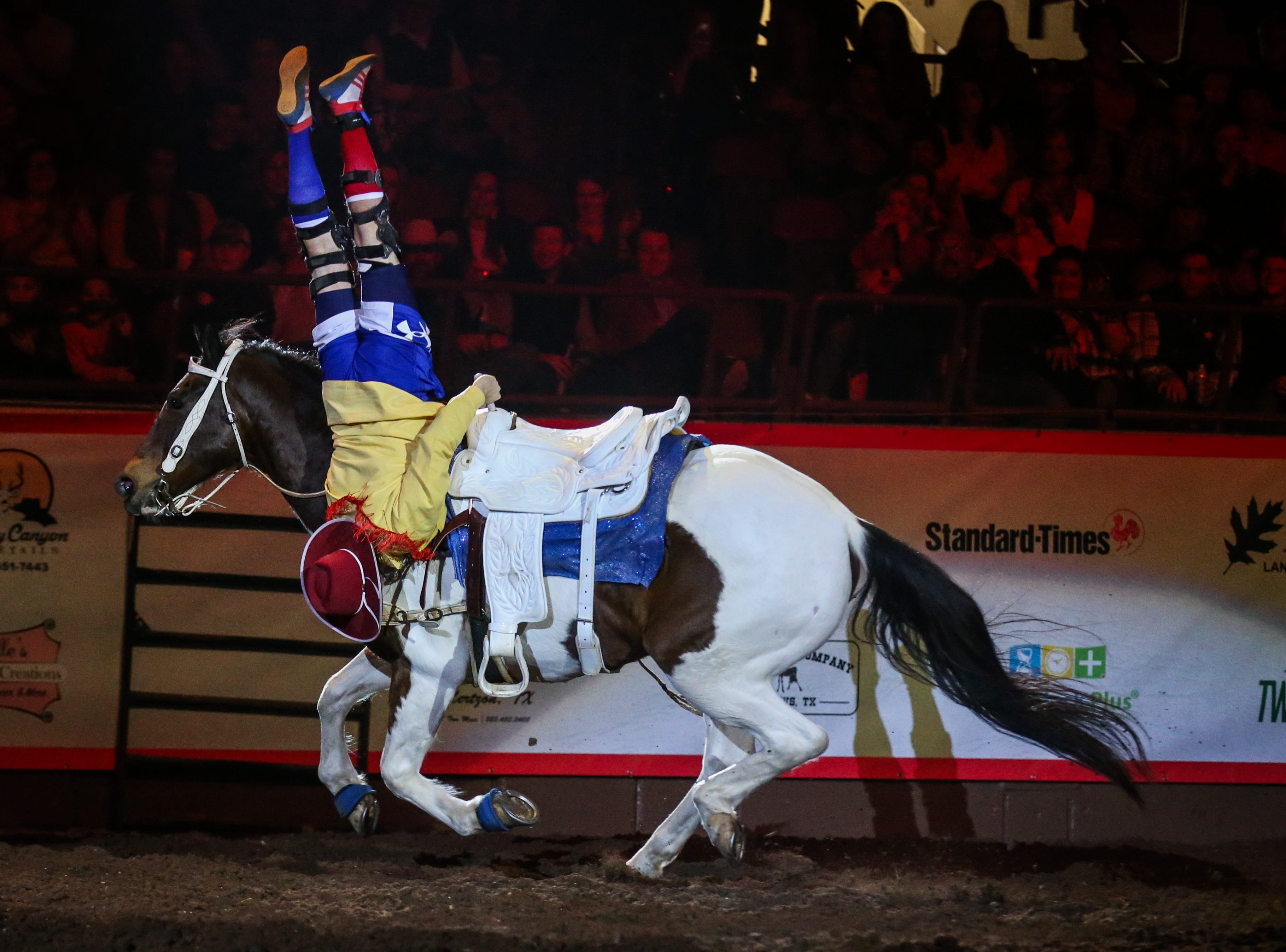 The rodeo clown performs tricks on his horse during the 1st performance of the San Angelo Stock Show & Rodeo Friday, Feb. 1, 2019, at Foster Communications Coliseum.