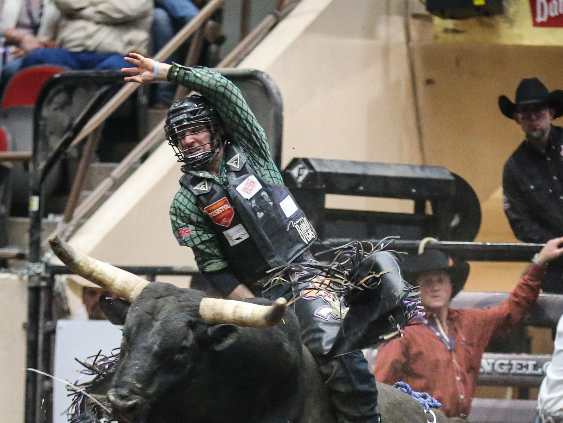 Garrett Smith rides a bull during the 1st performance of the San Angelo Stock Show & Rodeo Friday, Feb. 1, 2019, at Foster Communications Coliseum.