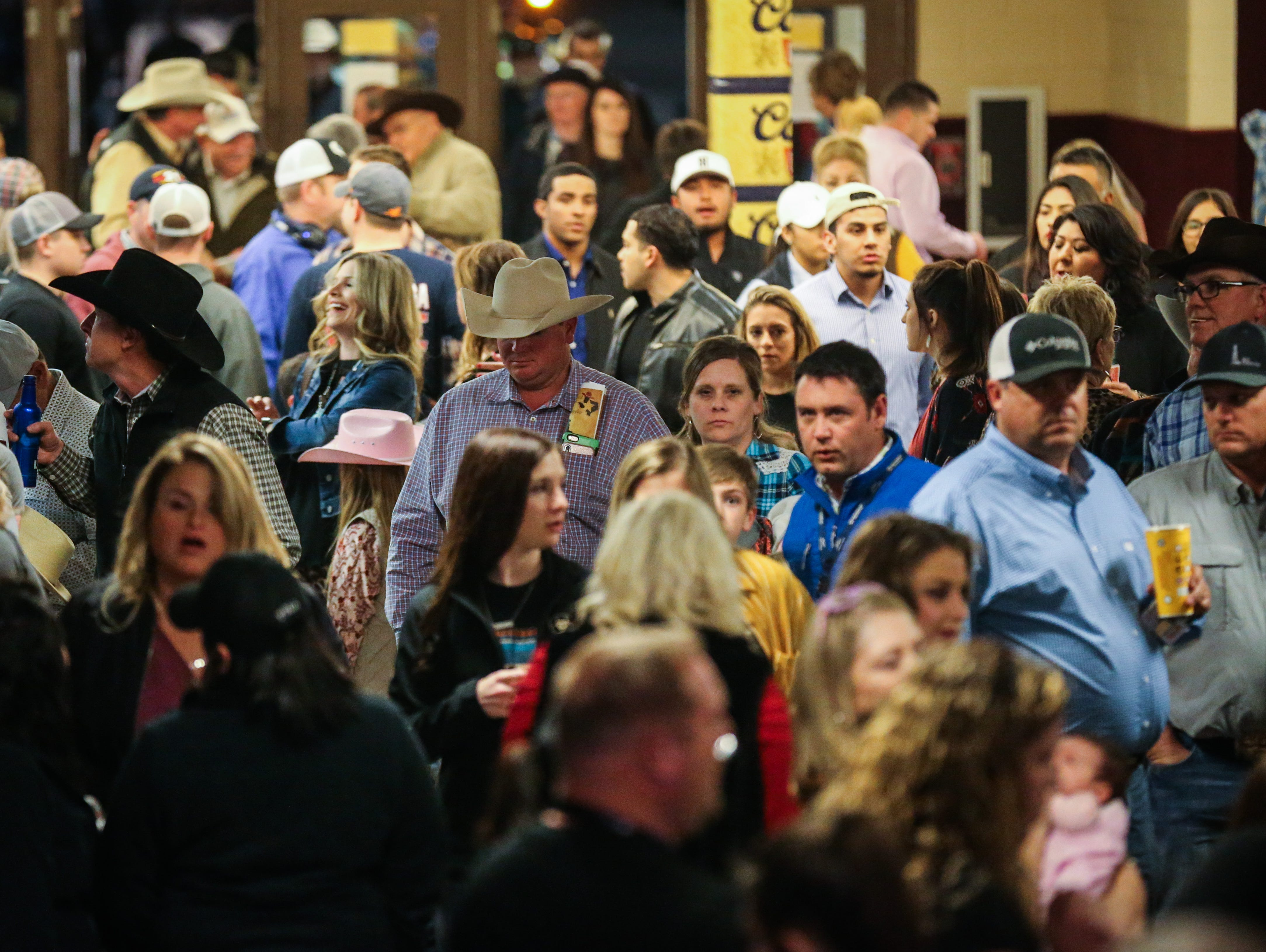 The crowd piles into the arena for the 1st performance of the San Angelo Stock Show & Rodeo Friday, Feb. 1, 2019, at Foster Communications Coliseum.