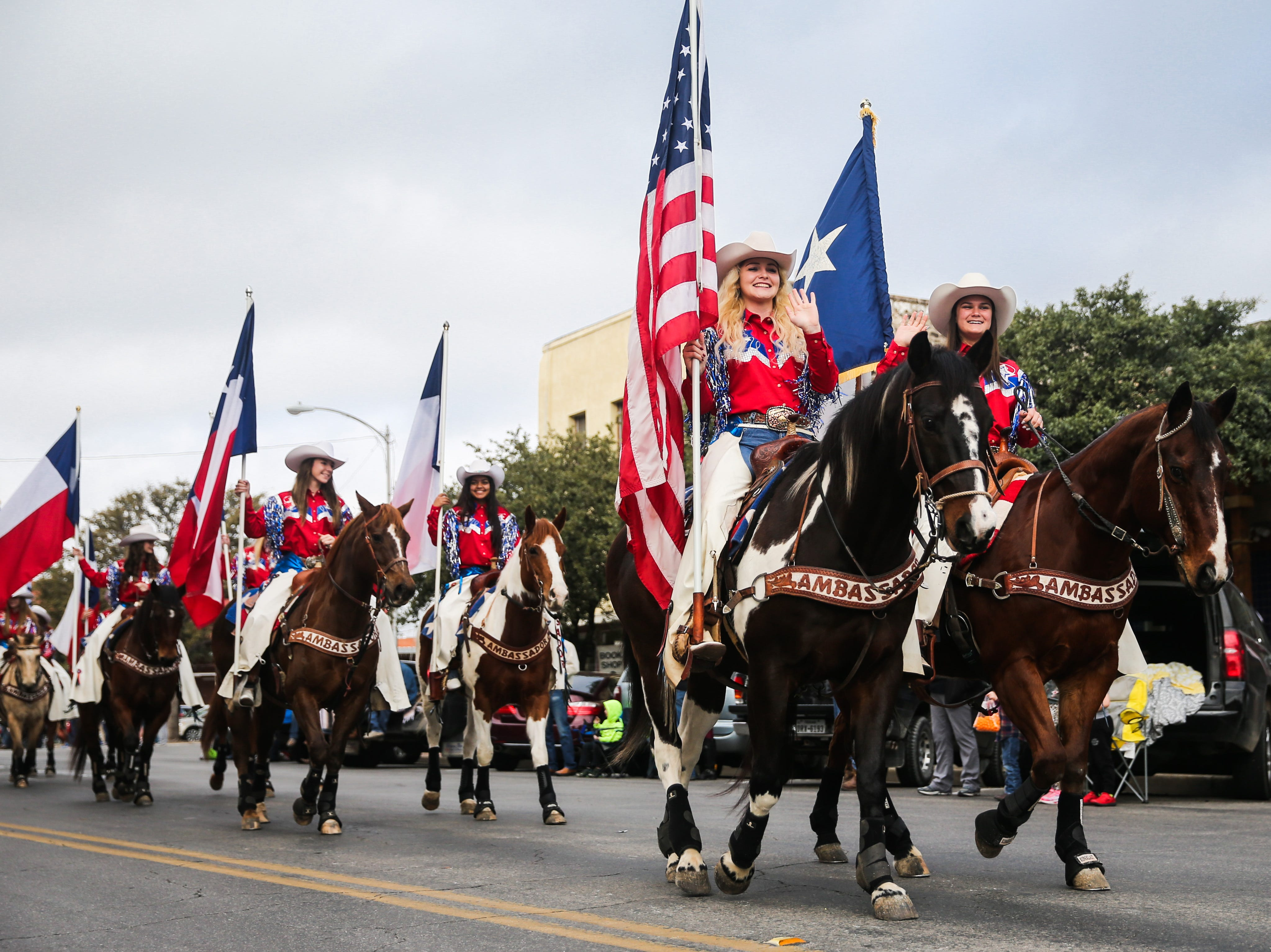 The San Angelo Ambassadors ride during the San Angelo Stock Show and Rodeo Parade to start Saturday, Feb. 2, 2019, in downtown San Angelo.