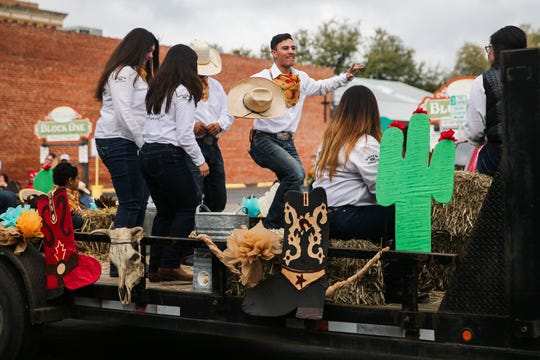 Parade participants dance on a float during the San Angelo Stock Show and Rodeo Parade to start Saturday, Feb. 2, 2019, in downtown San Angelo.