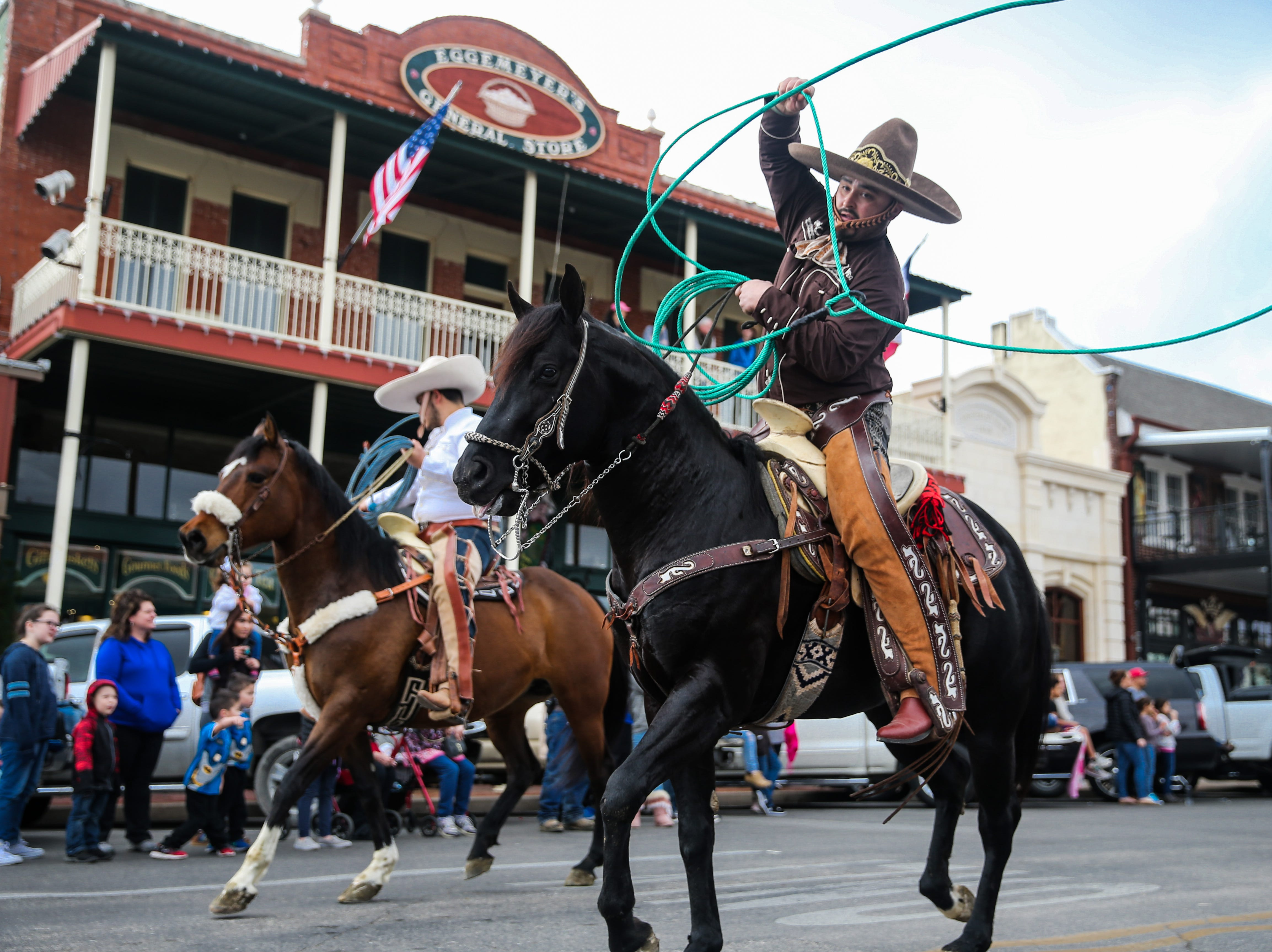 Parade participants ride during the San Angelo Stock Show and Rodeo Parade to start Saturday, Feb. 2, 2019, in downtown San Angelo.