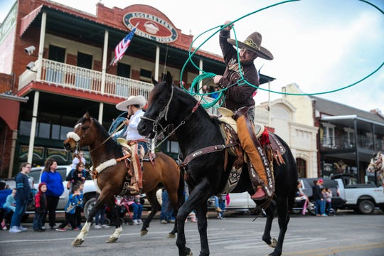 Parade participants ride during the San Angelo Stock Show & Rodeo Parade to start Saturday, Feb. 2, 2019, in downtown San Angelo.
