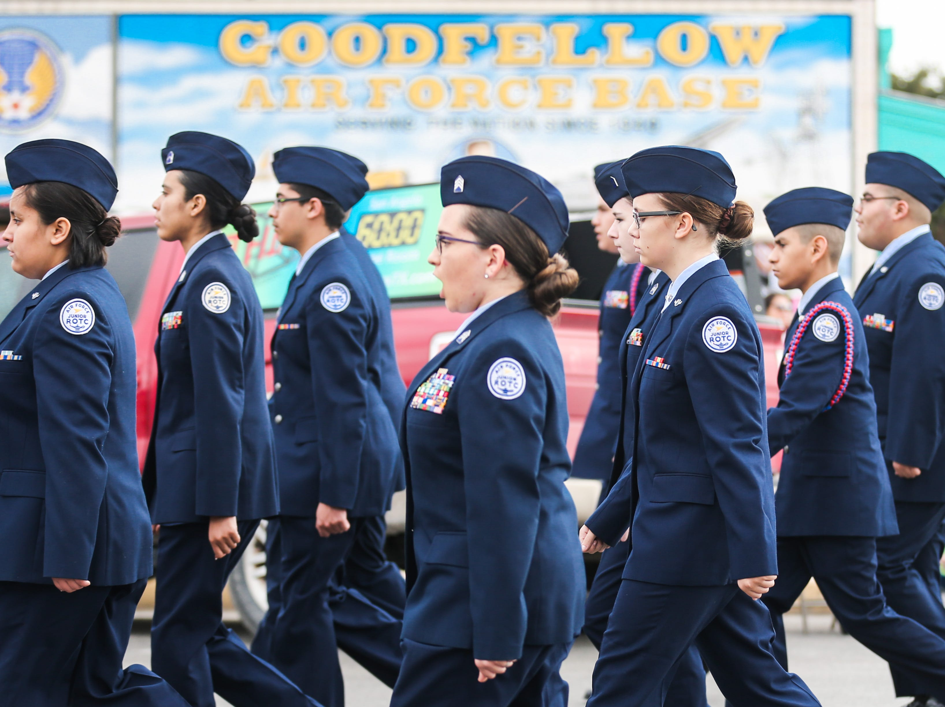 Air Force ROTC members march during the San Angelo Stock Show and Rodeo Parade to start Saturday, Feb. 2, 2019, in downtown San Angelo.