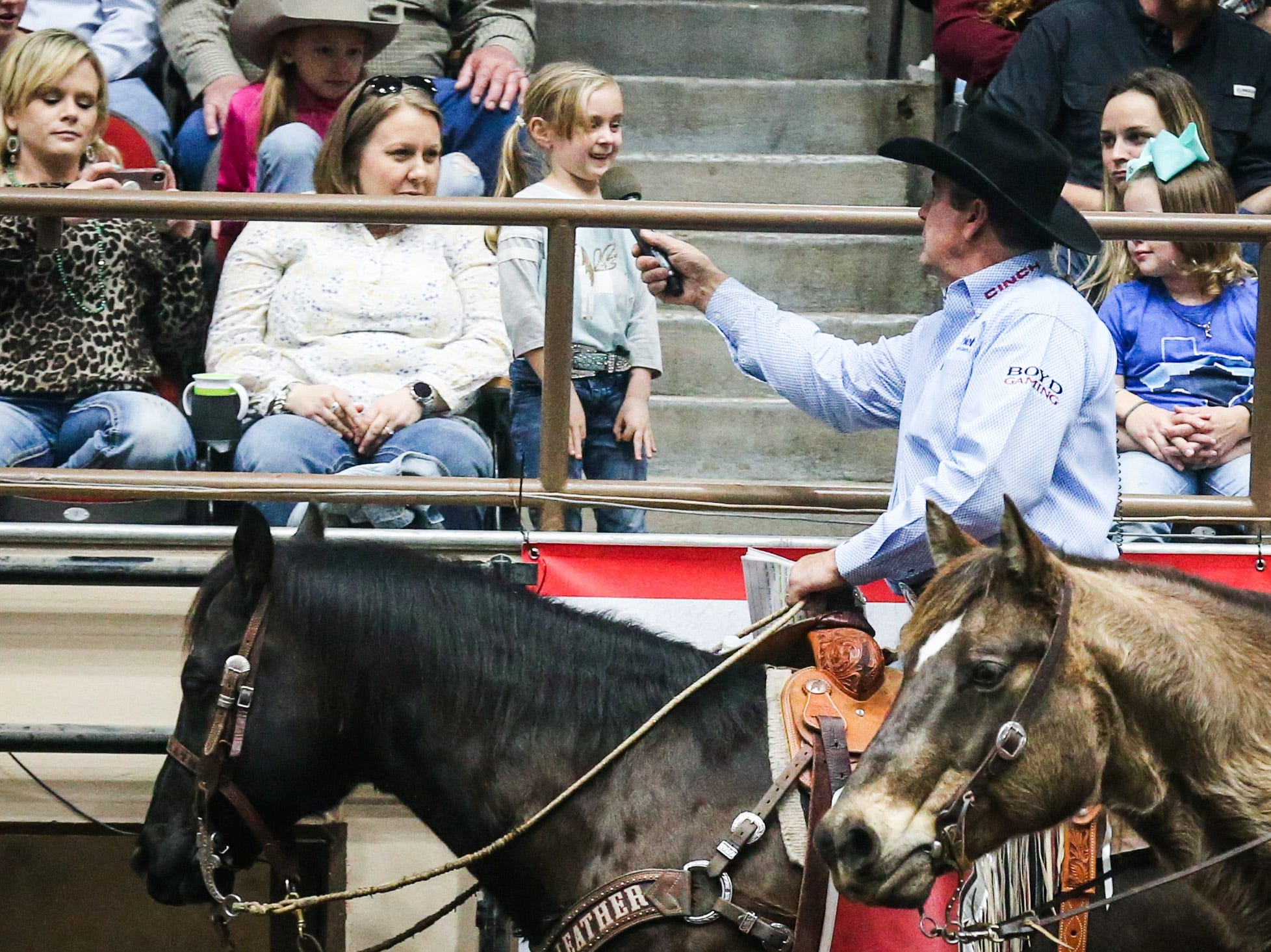 Announcer Boyd Polhamus chats with a girl in the audience during the 2nd performance of the San Angelo Stock Show & Rodeo  Saturday, Feb. 2, 2019, at Foster Communications Coliseum.