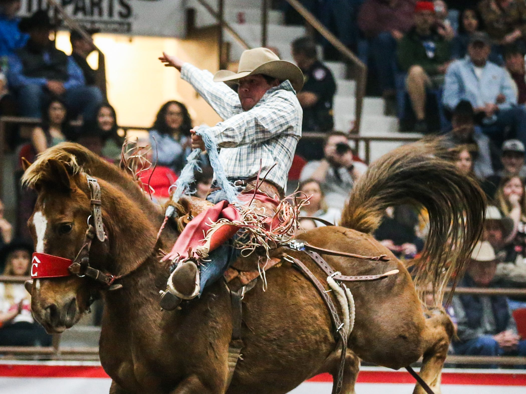 Preston Burr rides a bronc during the 2nd performance of the San Angelo Stock Show & Rodeo  Saturday, Feb. 2, 2019, at Foster Communications Coliseum.