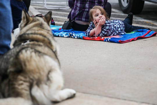 Hailey Stewart, 3, waits for the San Angelo Stock Show & Rodeo Parade to start Saturday, Feb. 2, 2019, in downtown.