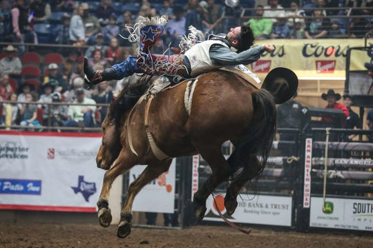 Taylor Broussard rides bareback during the 1st performance of the San Angelo Stock Show & Rodeo Friday, Feb. 1, 2019, at Foster Communications Coliseum.