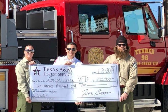 From left: Monica Harris, Texas A&M Forest Service Regional Fire Coordinator, Aaron Flint, Grape Creek VFD Fire Chief, and Cody Lambert, Texas A&M Forest Service Regional Fire Coordinator.