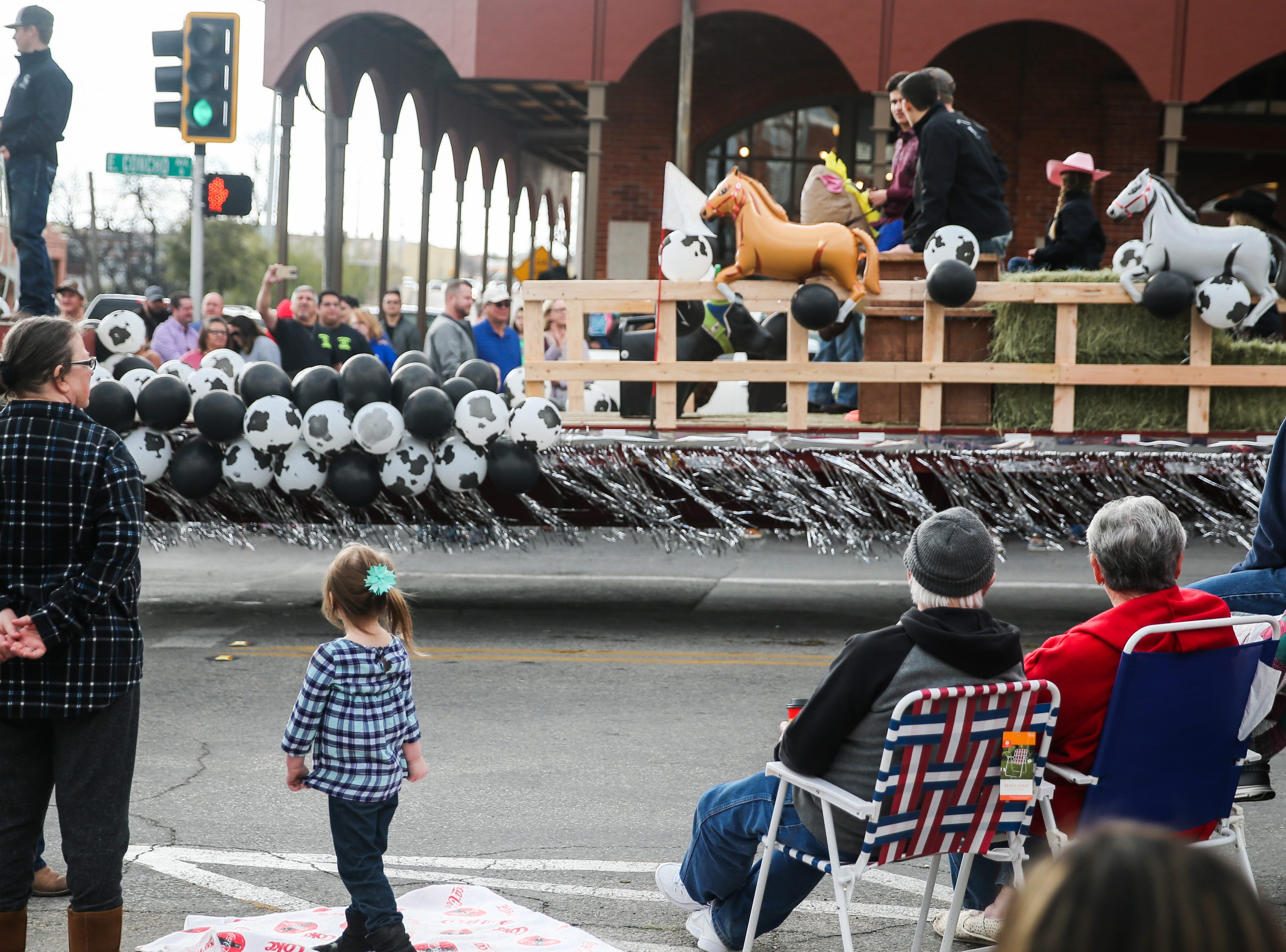Parade participants make their way down the street during the San Angelo Stock Show and Rodeo Parade to start Saturday, Feb. 2, 2019, in downtown San Angelo.